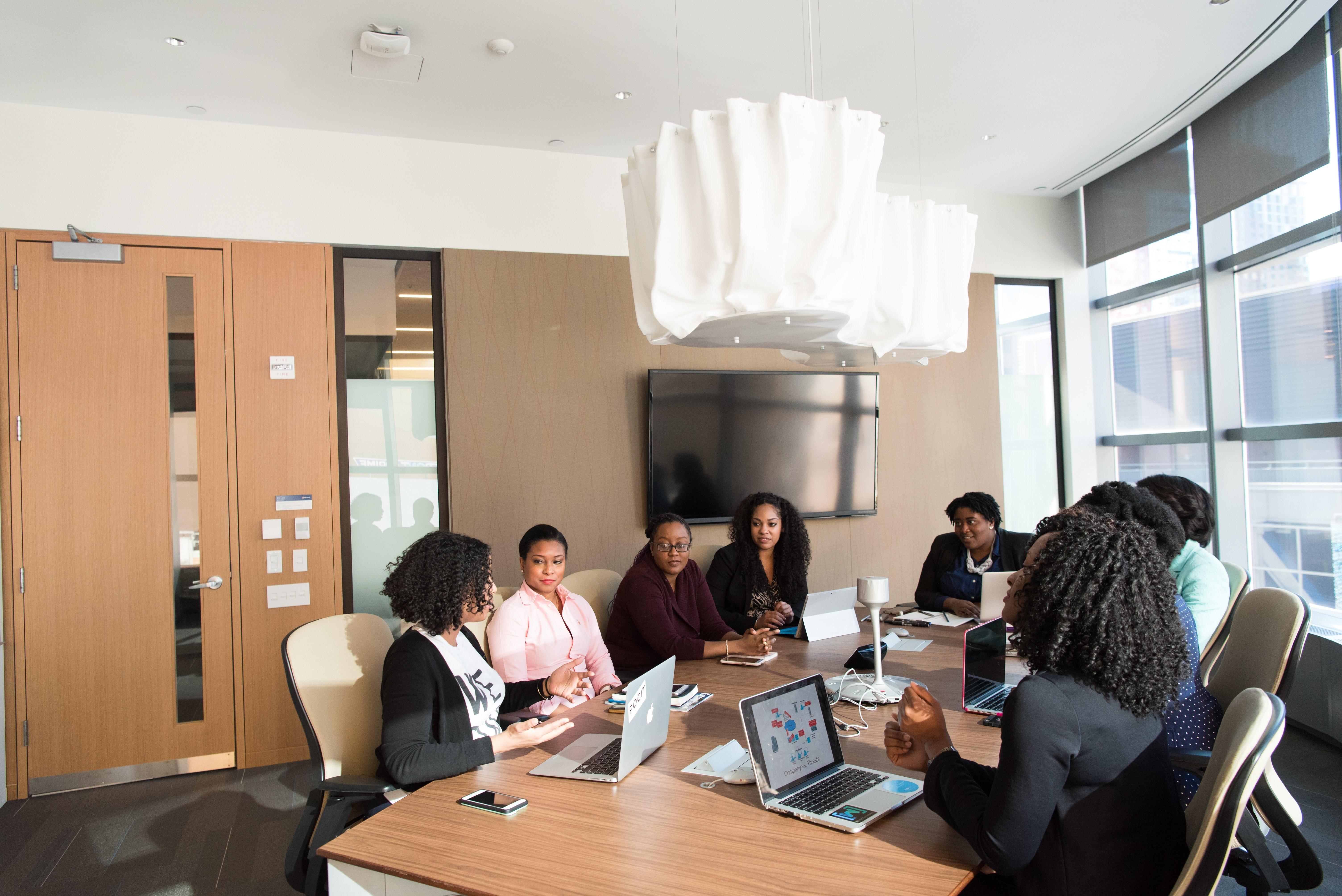 Black women in boardroom.