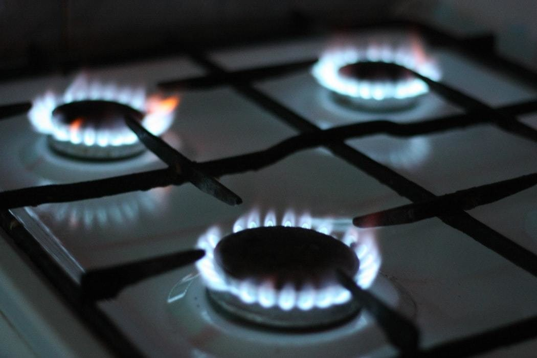 3 gas fired hobs are shown lit.