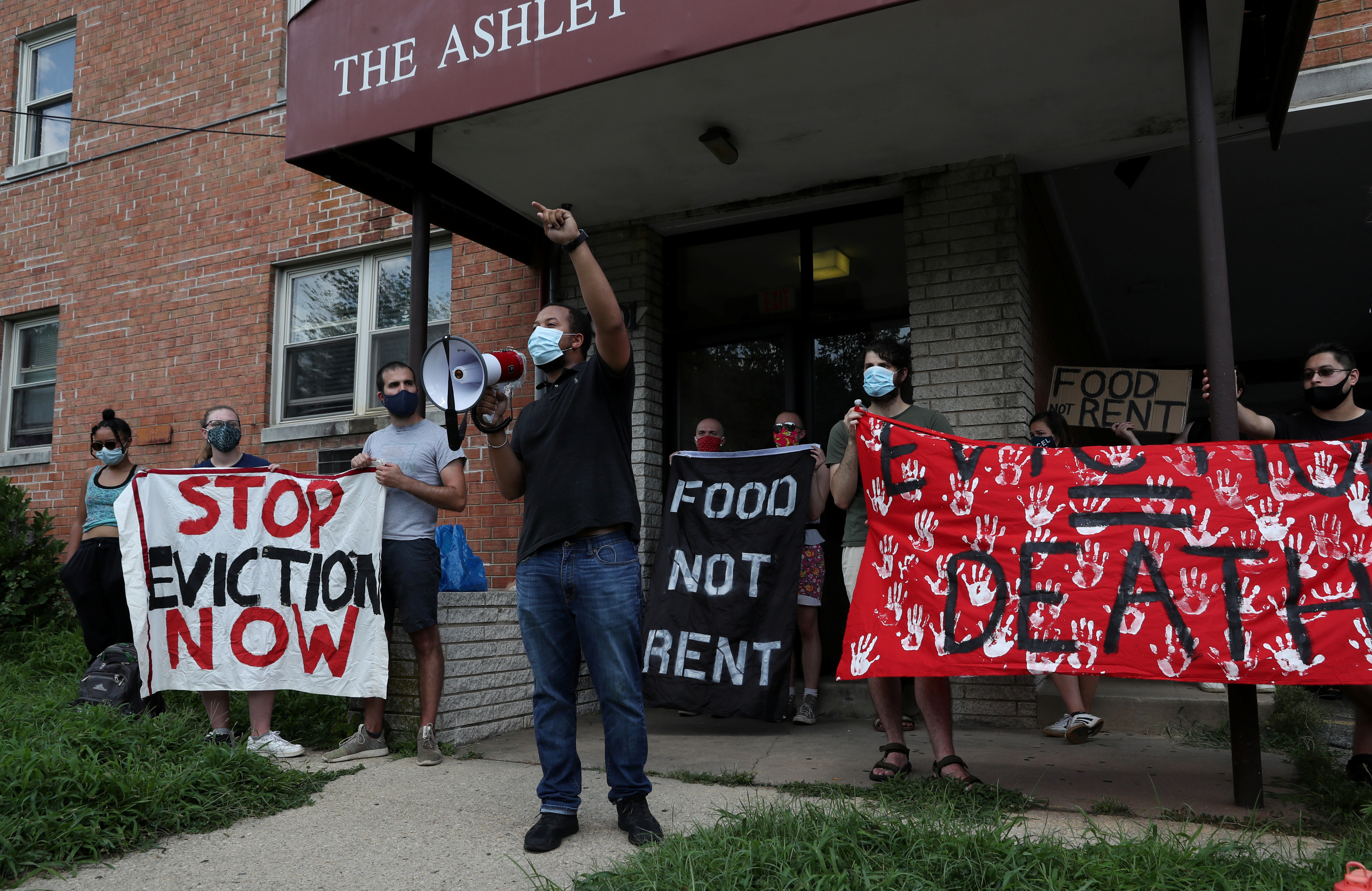 Maryland Rep Julian Ivey speaks out about evictions after gathering with others outside of an apartment complex with the intention to stop the alleged eviction of one of the tenants in Mount Rainier, MD, U.S., August 10, 2020. While Maryland remains under a State of Emergency, evictions are prohibited for tenants who are 'suffering substantial loss of income due to COVID-19'. Picture taken August 10, 2020. REUTERS/Leah Millis - RC2KCI92EWNL