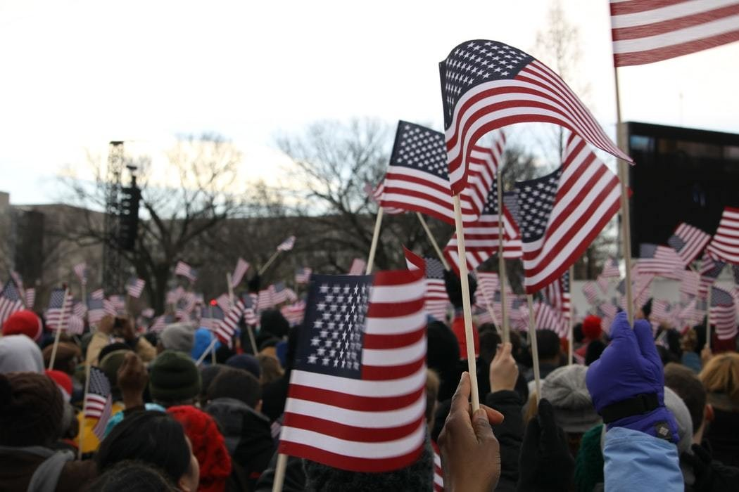 American citizens flying American flags