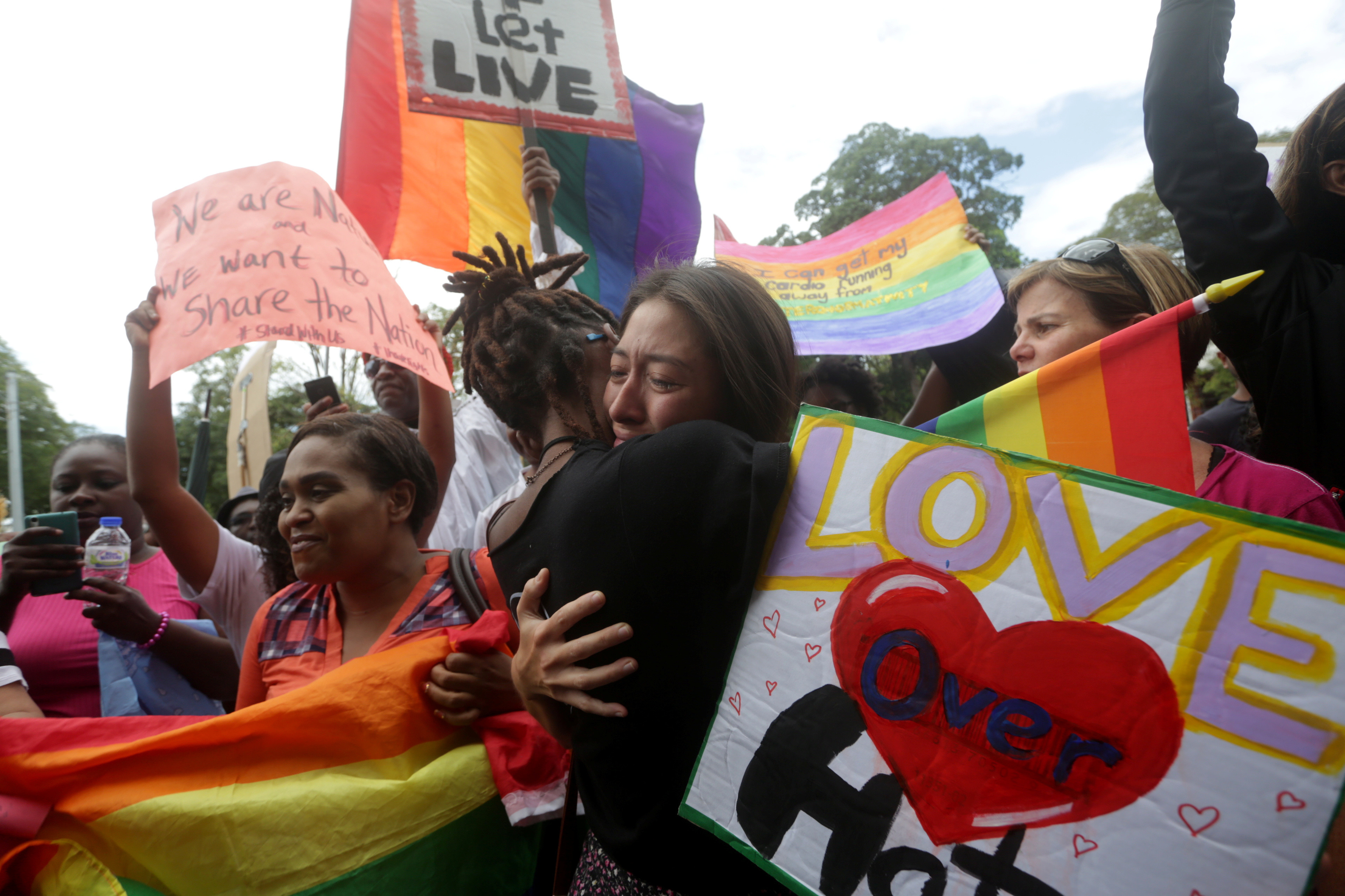 Members of the LGBT community demonstrate outside the Hall of Justice in Port-of-Spain, Trinidad and Tobago April 12, 2018.  REUTERS/Andrea de Silva - RC1701B8E570