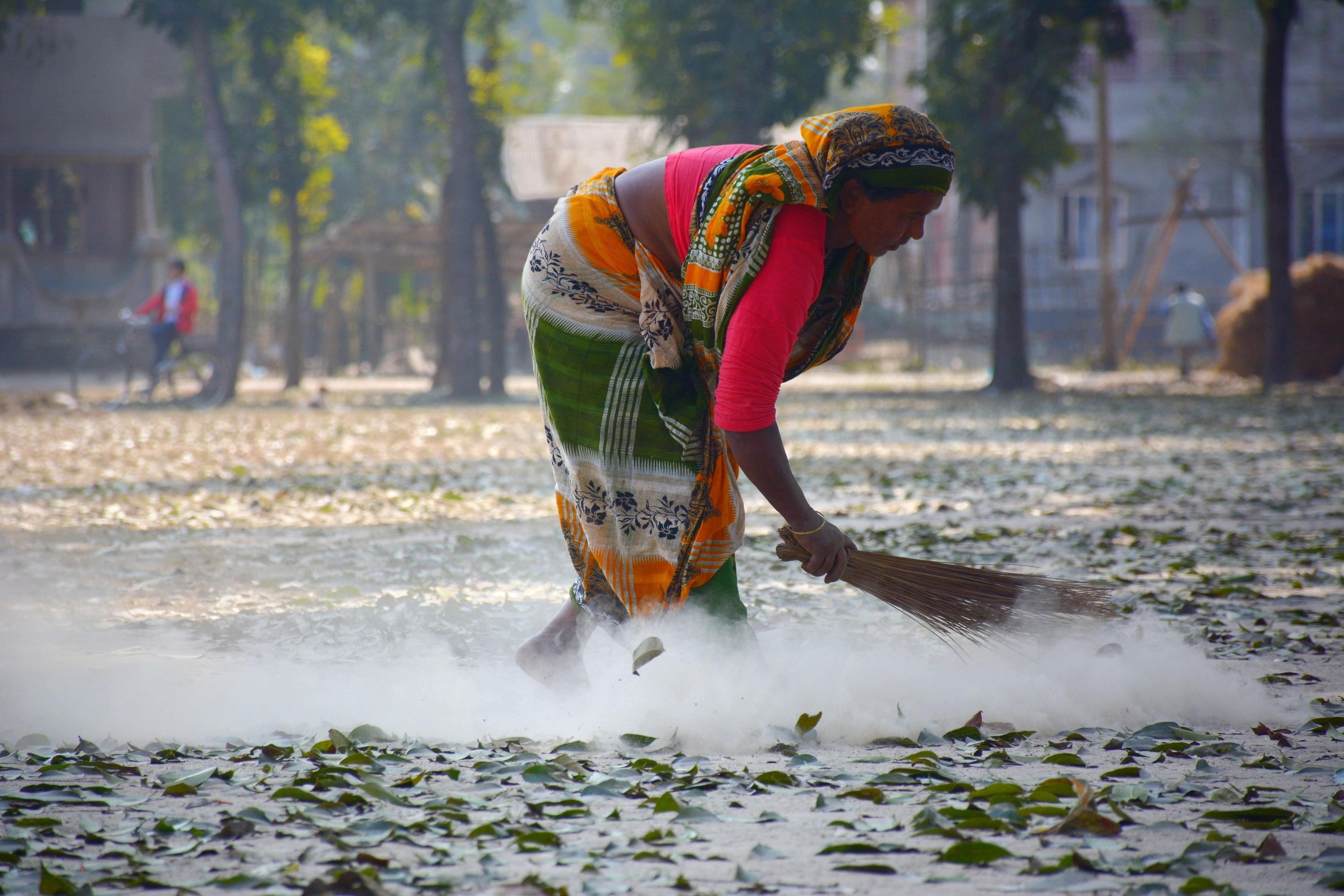 a women sweeps the floor