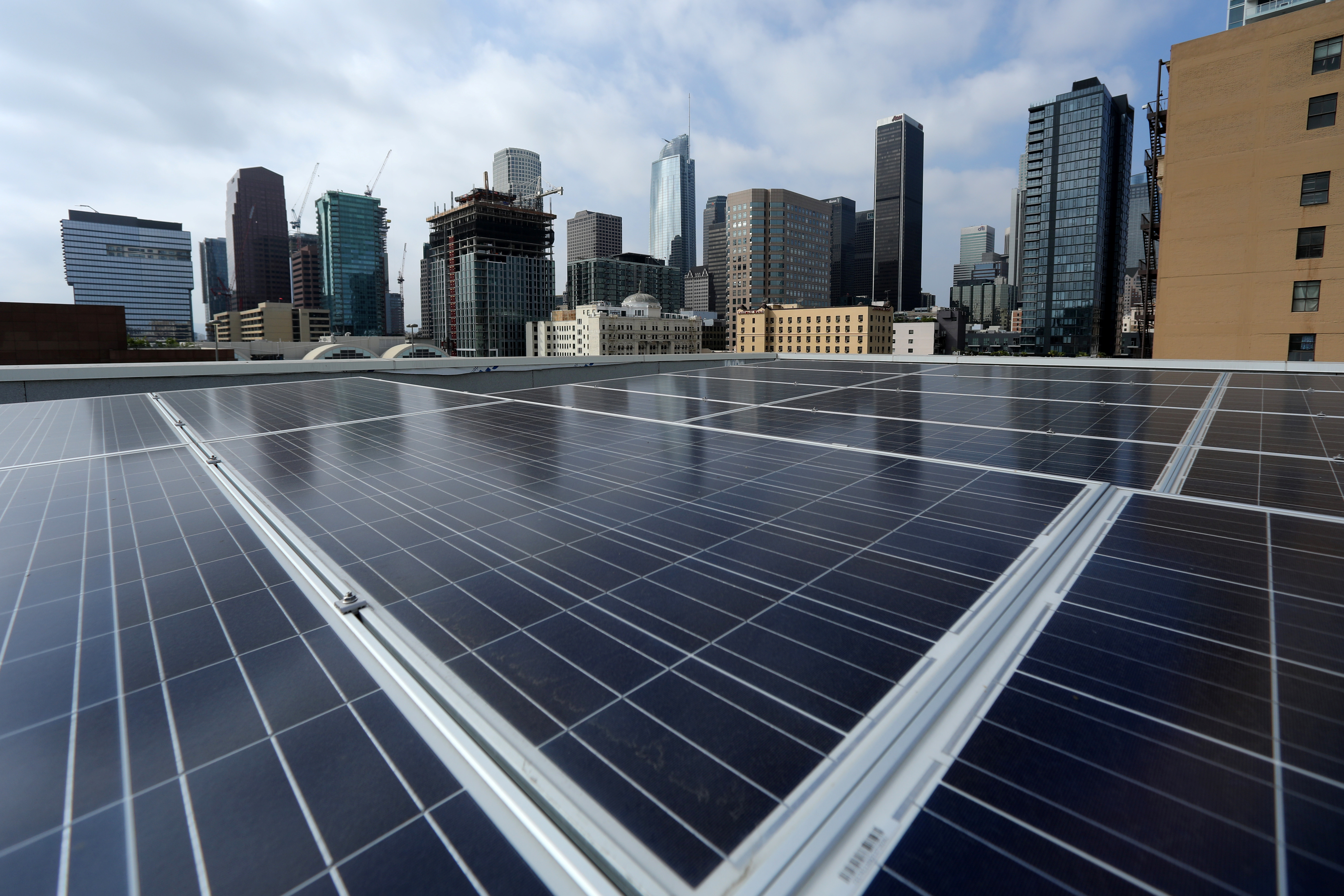 Solar electric panels are shown installed on the roof of the Hanover Olympic building, the first building to offer individual solar-powered net-zero apartments in Los Angeles, California, U.S., June 6, 2017.