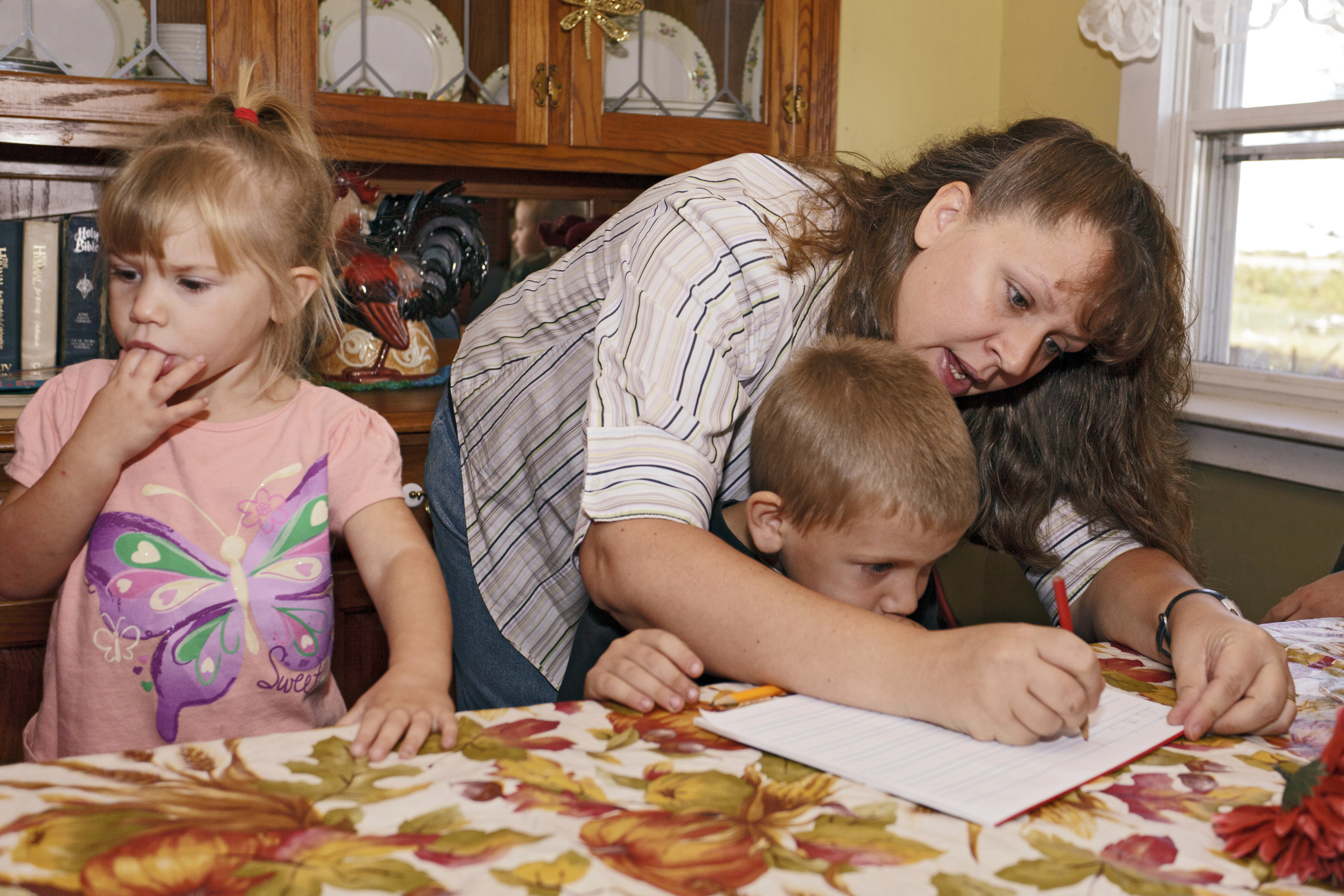 Christa Keagle works with her children Rebekah, 3, and Joshua Keagle, 6, during a homeschool assignment in St. Charles, Iowa September 30, 2011. After decades on the margins of political life, homeschoolers have become some of the most valued Republican foot soldiers in Iowa, where a few thousand activists can wield an outsize influence in the first nominating contest in the 2012 presidential election. Picture taken September 30.    REUTERS/Brian C. Frank  (UNITED STATES - Tags: POLITICS EDUCATION ELECTIONS) - GM1E7A409EJ01