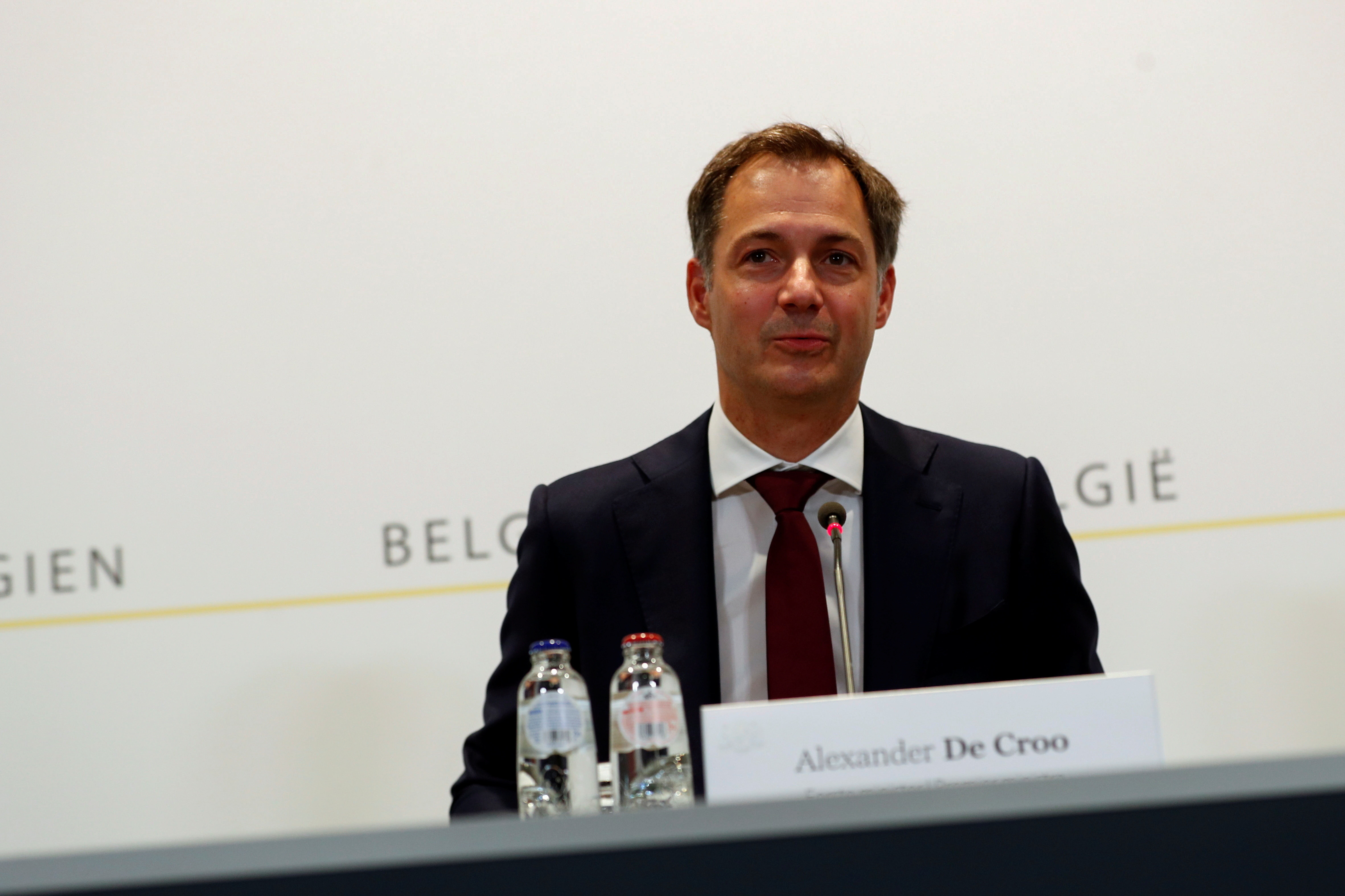 Belgium's Prime Minister Alexander De Croo attends a news conference after a government meeting to announce the new coronavirus disease (COVID-19) related measures in Brussels, Belgium June 4, 2021.