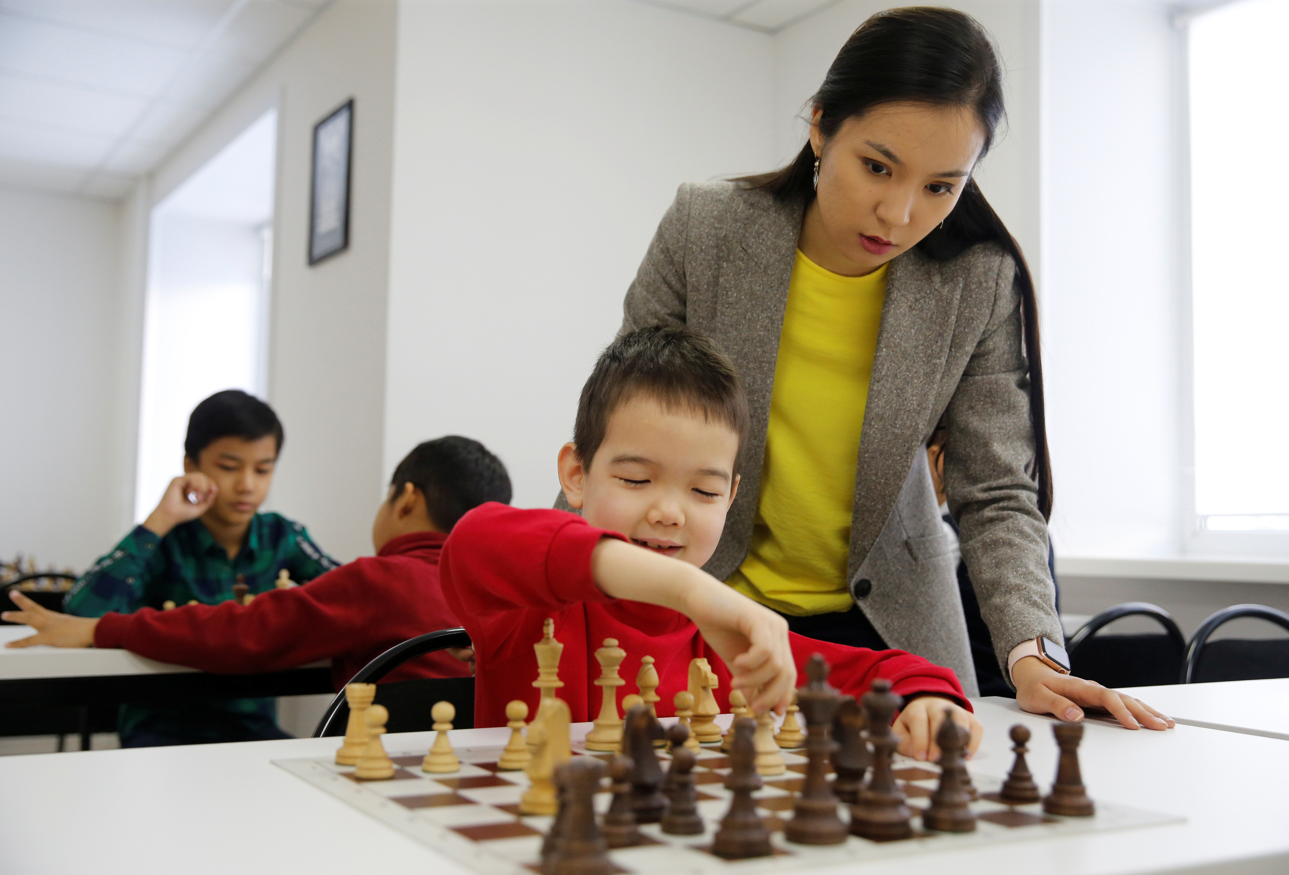 Dinara Saduakassova, a 23-year-old Kazakh chess player and social activist, teaches children in the Chess Academy she founded in Nur-Sultan, Kazakhstan March 3, 2020. Saduakassova has opened a chain of chess schools in the country and has become a Goodwill Ambassador of the UNICEF. Picture taken March 3, 2020. REUTERS/Pavel Mikheyev - RC2ODF99KN3U