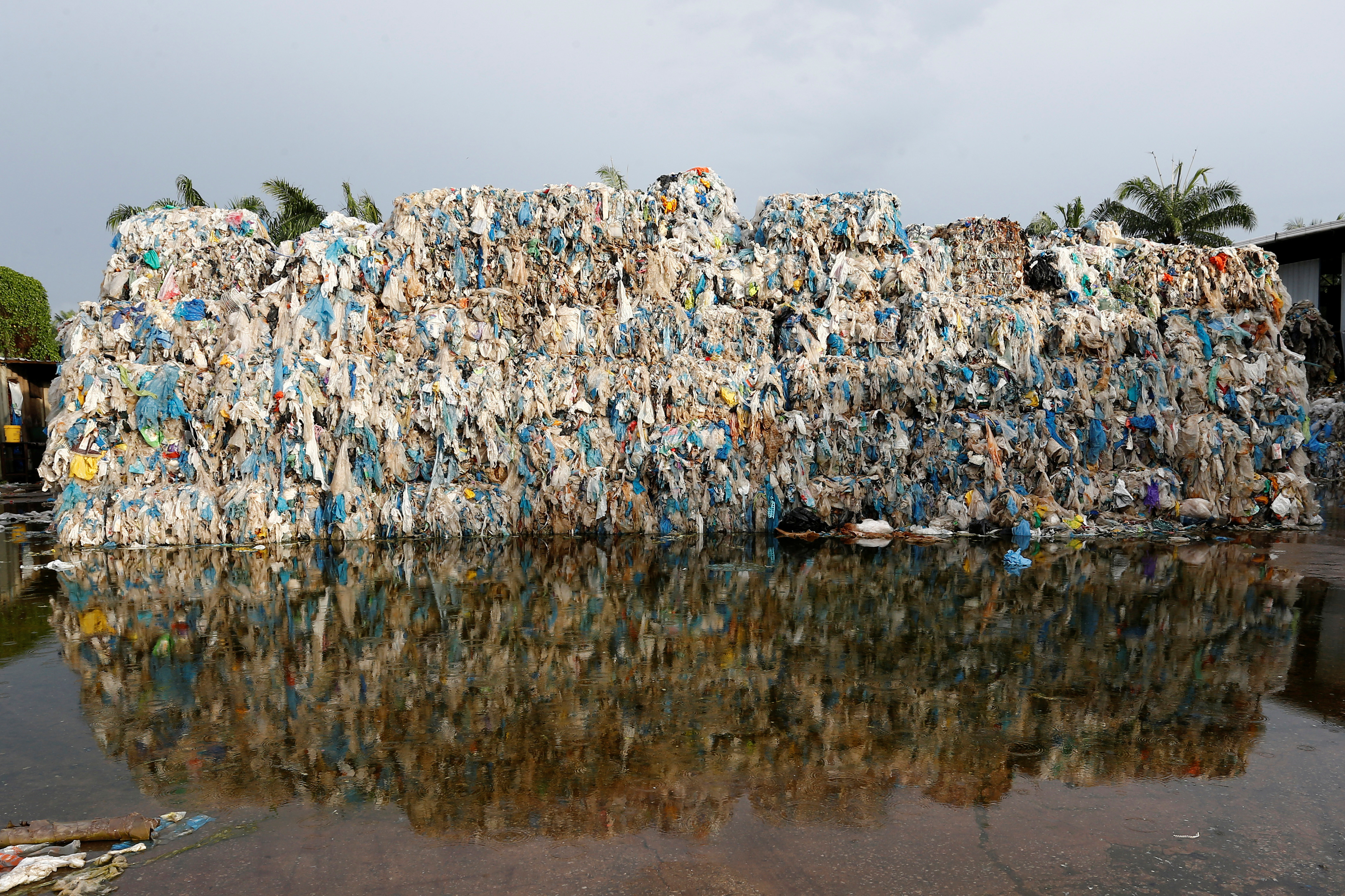 Plastic waste piled outside an illegal recycling factory in Jenjarom, Kuala Langat, Malaysia October 14, 2018. Picture taken October 14, 2018. REUTERS/Lai Seng Sin     TPX IMAGES OF THE DAY - RC11BAB877D0