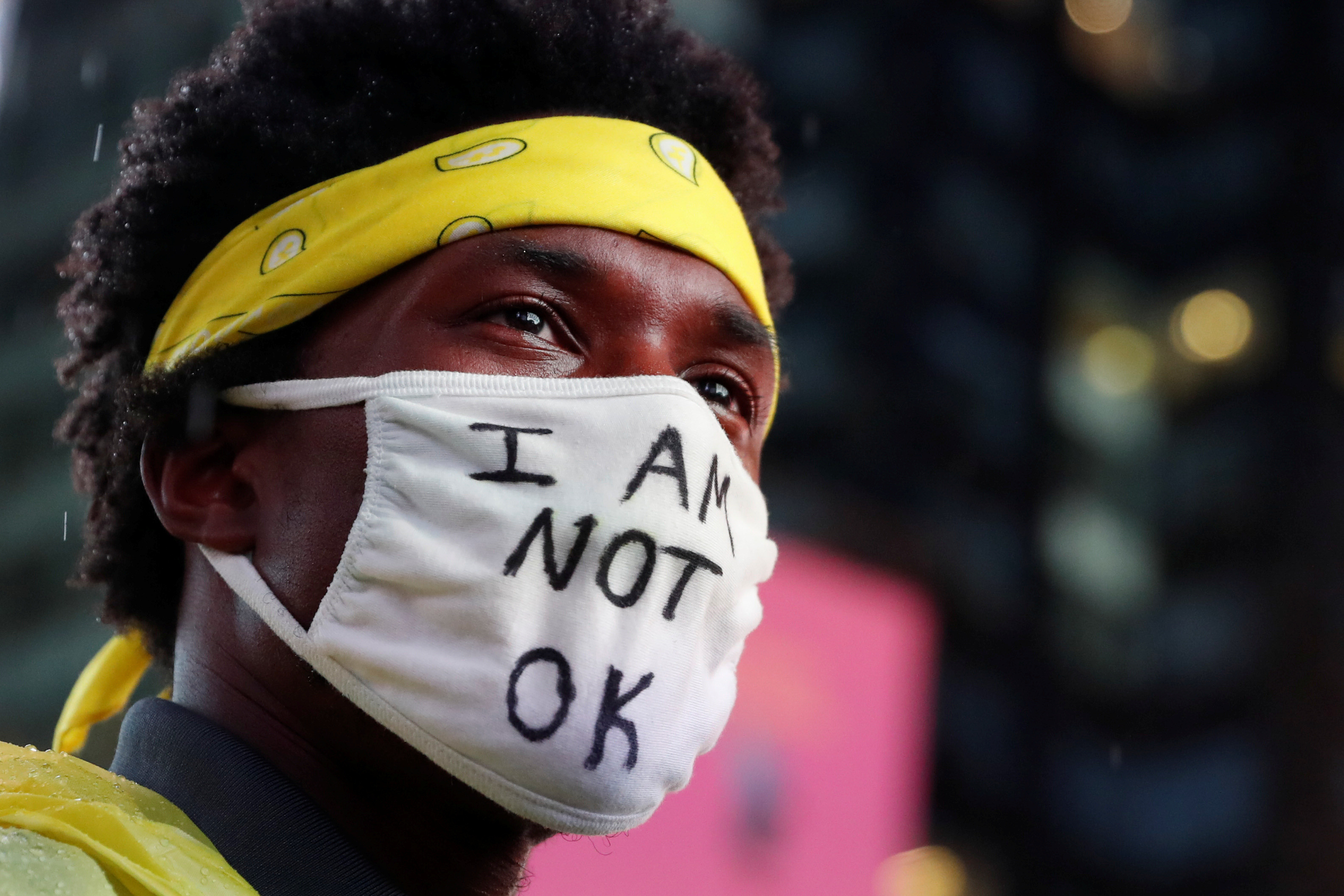 A demonstrator wearing a face mask takes part in a protest following the death of the Black man Daniel Prude, after police put a spit hood over his head during an arrest in Rochester on March 23, at Times Square in New York, U.S. September 3, 2020. REUTERS/Shannon Stapleton - RC2DRI97HLO8