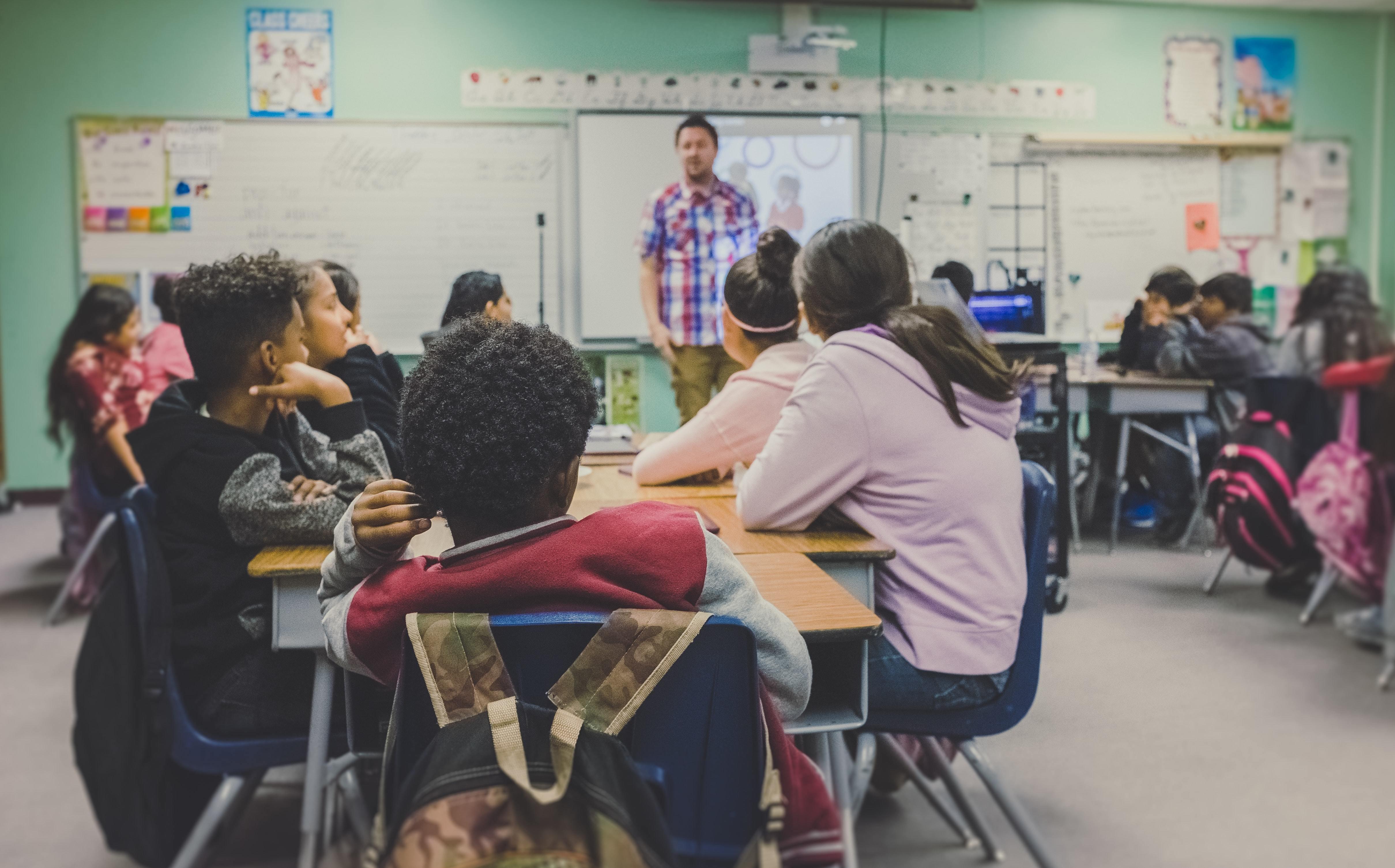 this is a teacher teaching his class; October 5 is World Teachers Day