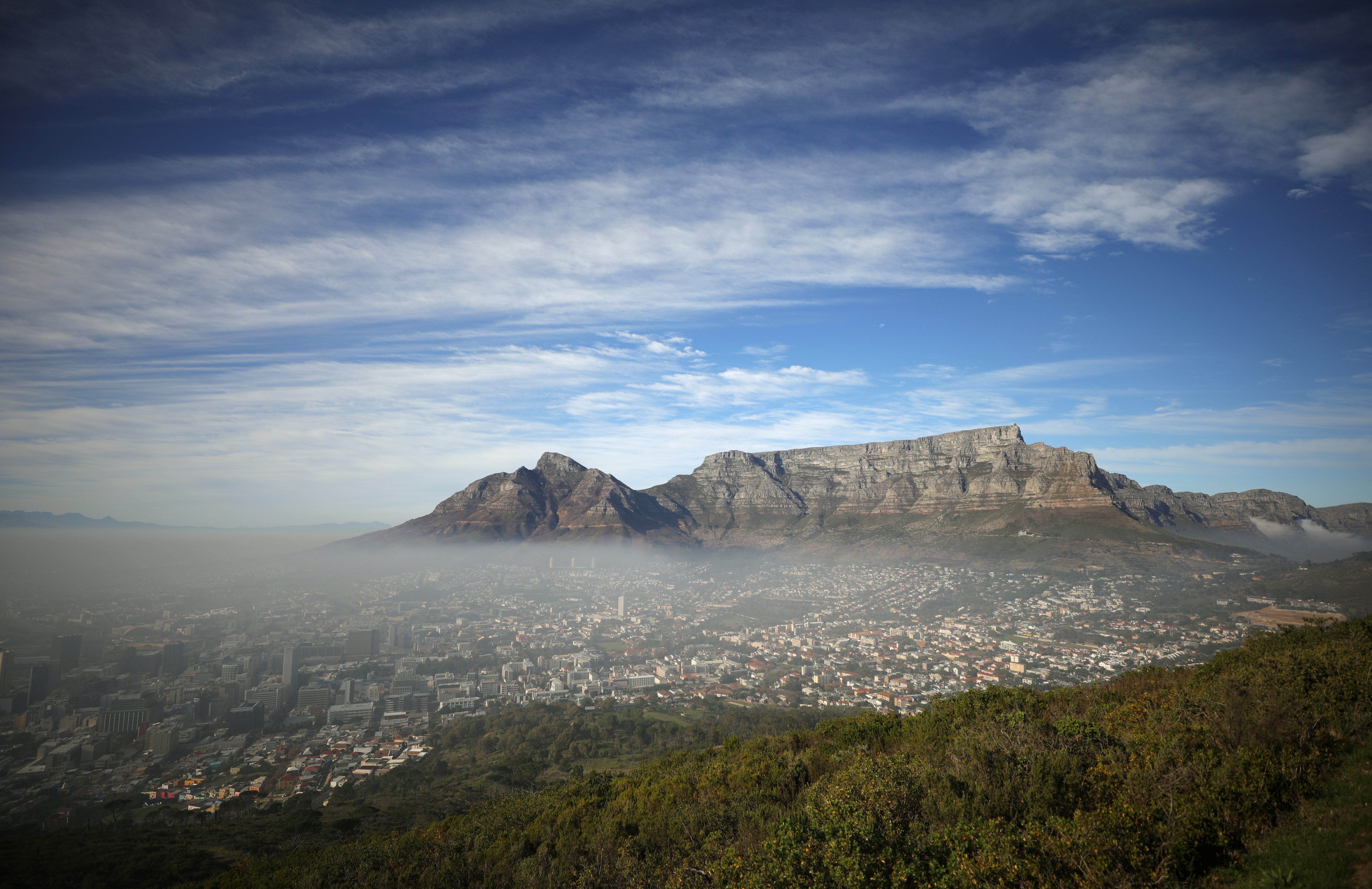 Seasonal fog disapates over the city beneath Table Mountain in Cape Town, South Africa, June 12,2021. REUTERS/Mike Hutchings - RC2YYN9T5LLQ