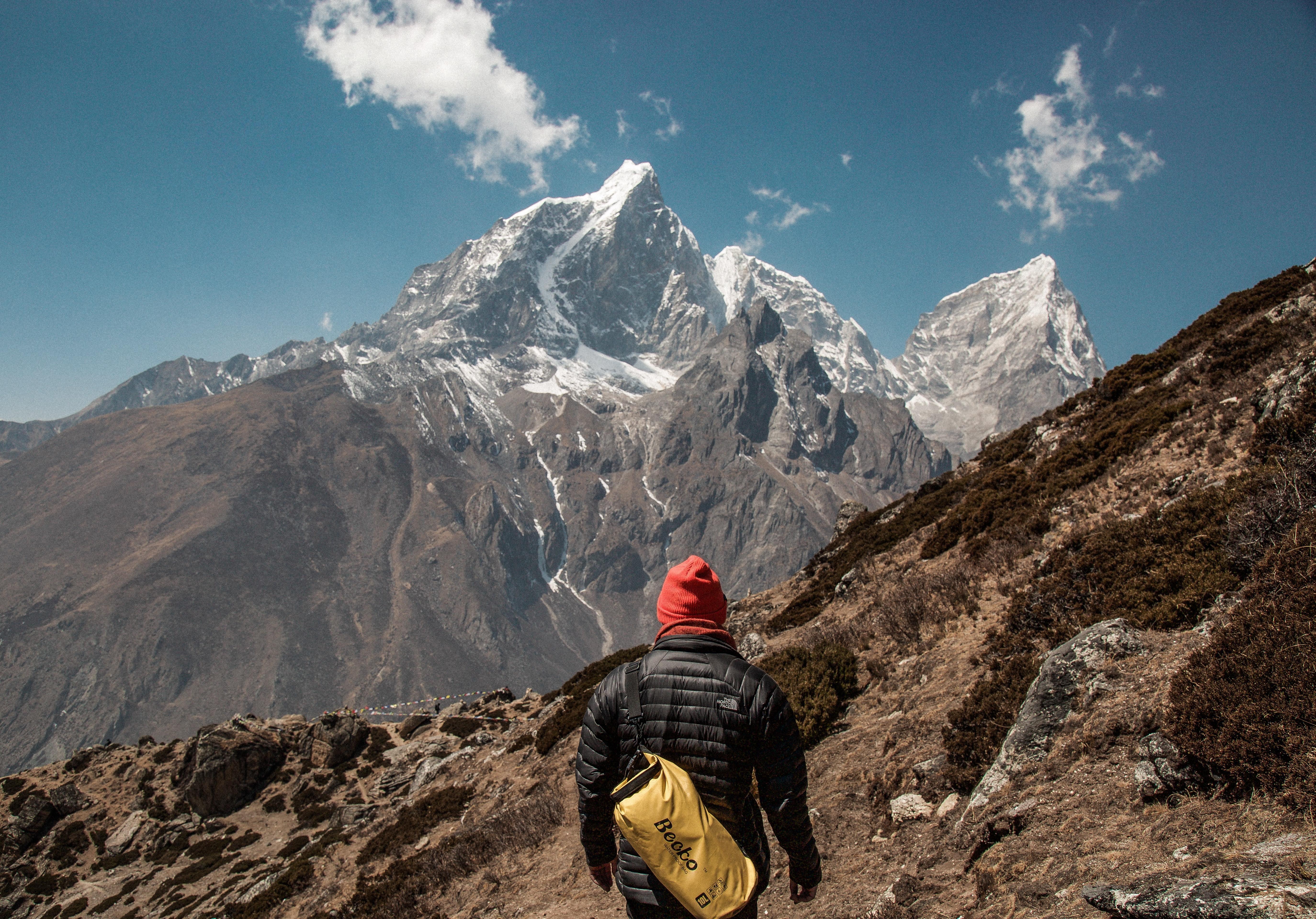 A man climbing a mountain.