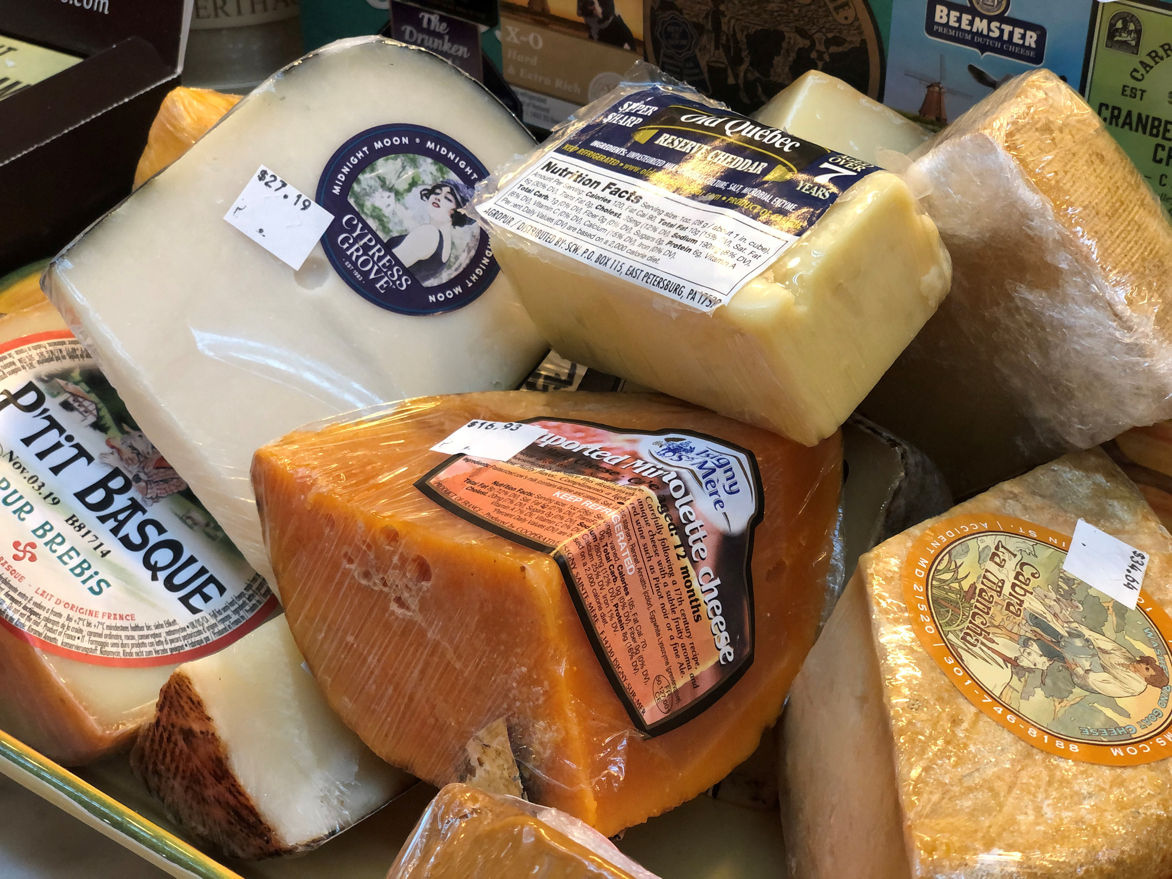 Imported European cheeses are seen on display at the Bowers Fancy Dairy Products shop in Washington's Eastern Market several weeks before the Trump administration's tariffs on European Union cheeses are set to kick in across the country and in Washington, U.S. October 3, 2019. Picture taken October 3, 2019.   REUTERS/Kevin Fogarty - RC1E7885CCE0