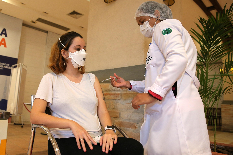 A pregnant Brazilian woman, Carolina de Lima, receives a dose of Pfizer/BioNTech coronavirus disease (COVID-19) vaccine in Sao Paulo, Brazil June 7, 2021.