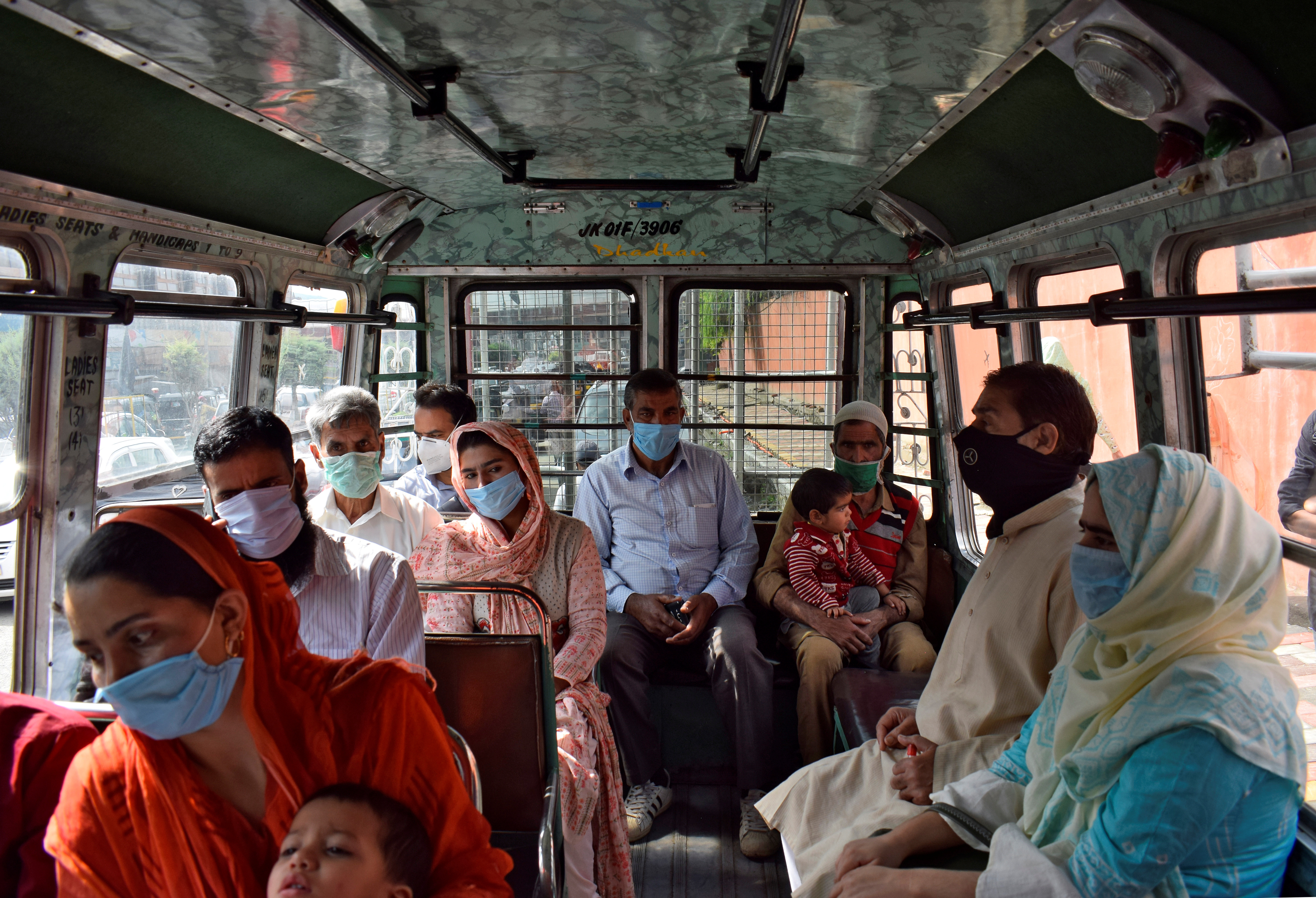 People wearing protective face masks travel in a passenger vehicle amidst the coronavirus disease (COVID-19) outbreak in Srinagar, September 7, 2020. REUTERS/Sanna Irshad Mattoo - RC2LTI9YFPH6