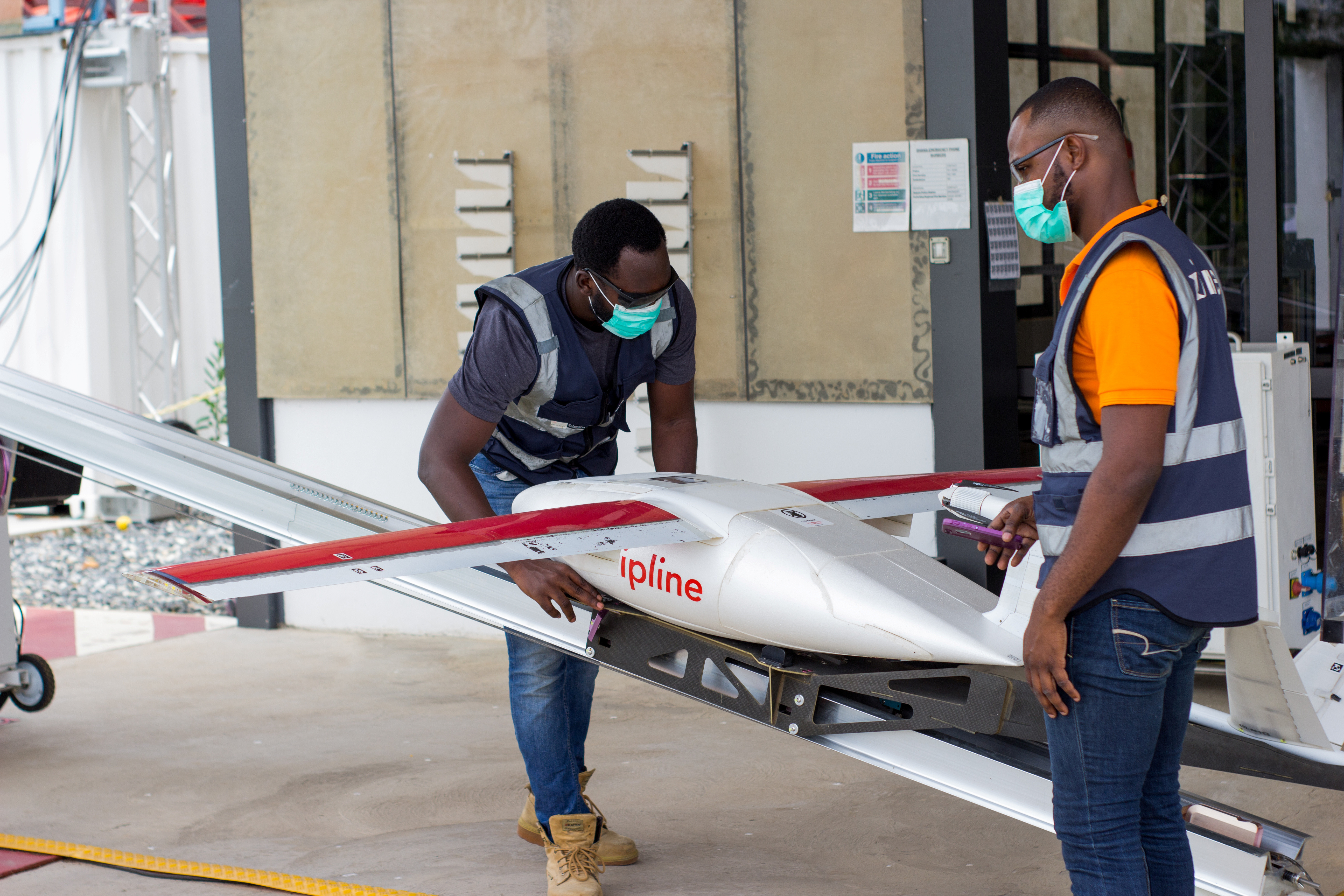 Flight operators perform pre-flight checks on a drone, amid the coronavirus disease (COVID-19) outbreak in Accra, Ghana April 16, 2020. Picture taken April 16, 2020. Zipline/Handout via REUTERS ATTENTION EDITORS - THIS IMAGE HAS BEEN SUPPLIED BY A THIRD PARTY - RC2LTI9R1U42