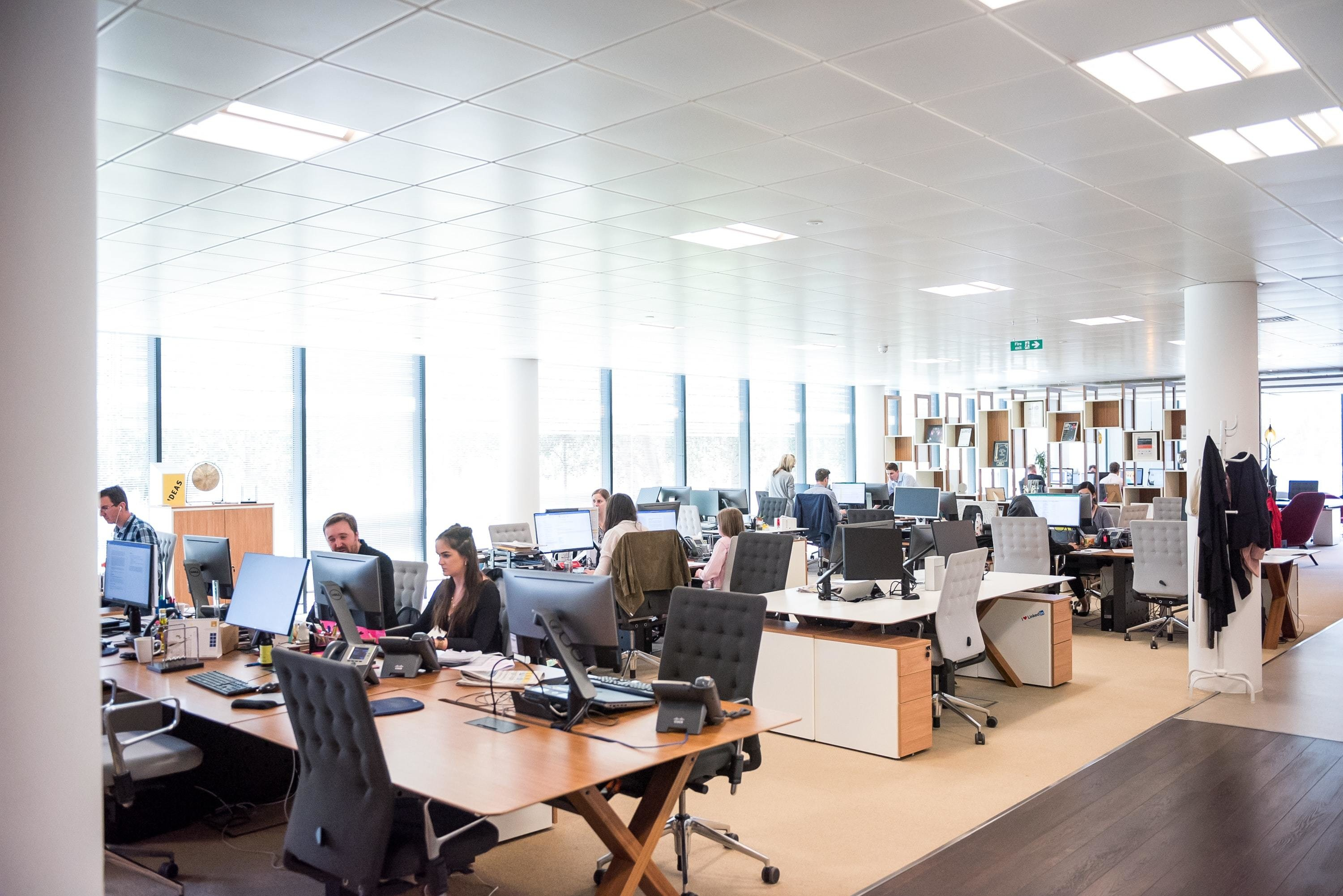 People pictured in an office, as a new Wharton report could help to create a more equal future at work.