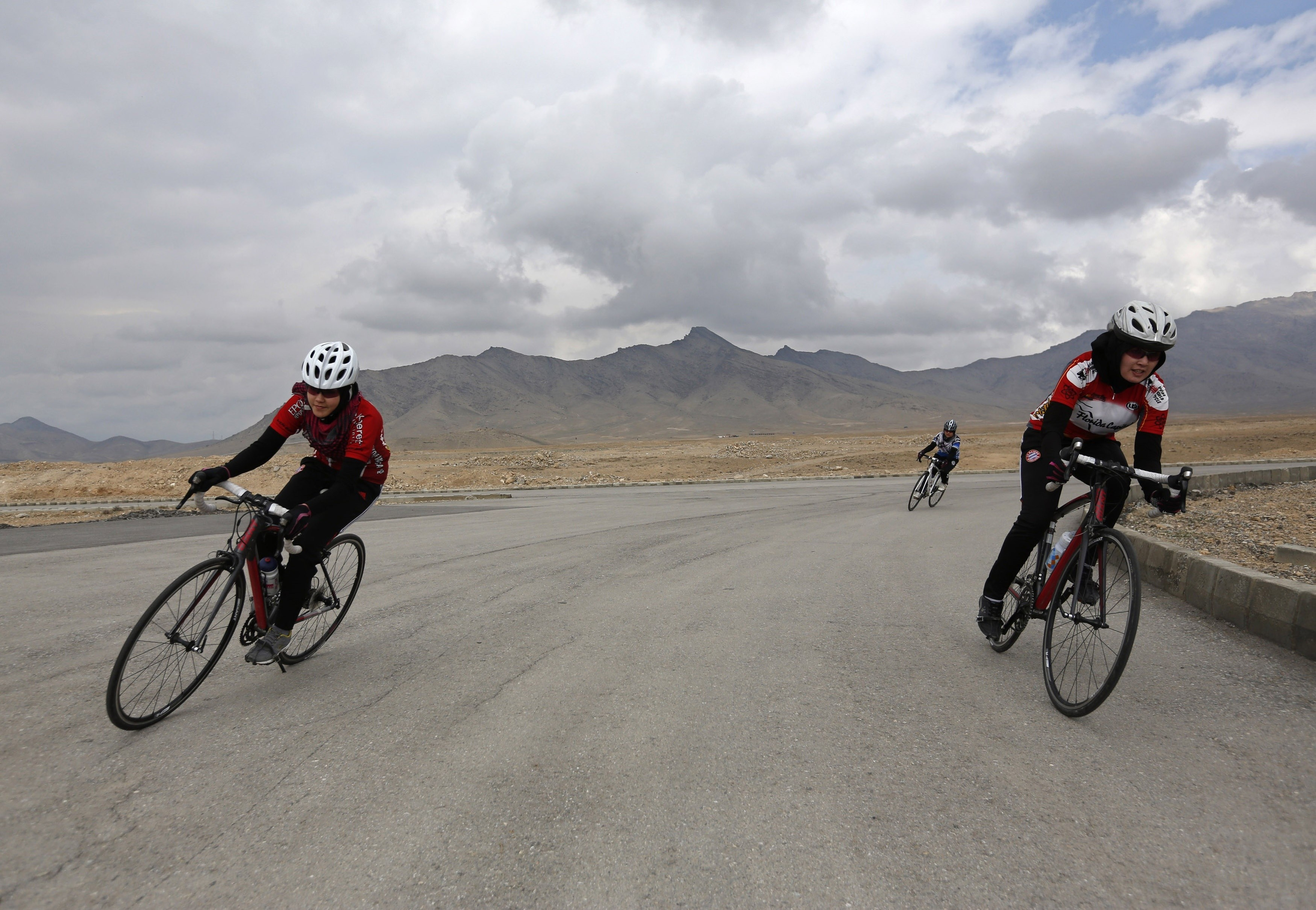 Masooma Alizada (L), and Zahra Alizada (R), member of Afghanistan's Women's National Cycling Team exercise on the outskirts of Kabul February 20, 2015. Afghanistan's Women's National Cycling Team has been breaking new ground for women's sports and pushing the boundaries of what is - and is not - acceptable for young women in the conservative Muslim country. Under the Taliban in the 1990s, women in Afghanistan were excluded from public life, banned from going to school or stepping outside their home without a male family member. Women's rights have made gains since the hardline Islamist group's ouster in 2001, but observers worry that progress is at risk as gender-based violence persists and women remain under-represented in politics. REUTERS/Mohammad Ismail (AFGHANISTAN - Tags: SPORT SOCIETY CYCLING)PICTURE 16 OF 24 FOR WIDER IMAGE STORY 'AFGHANISTAN'S WOMEN RACERS'SEARCH 'AFGHANISTAN CYCLING' FOR ALL IMAGESFOR BEST QUALITY IMAGE ALSO SEE: GF10000144534 - LM2EB3A15ZJ01