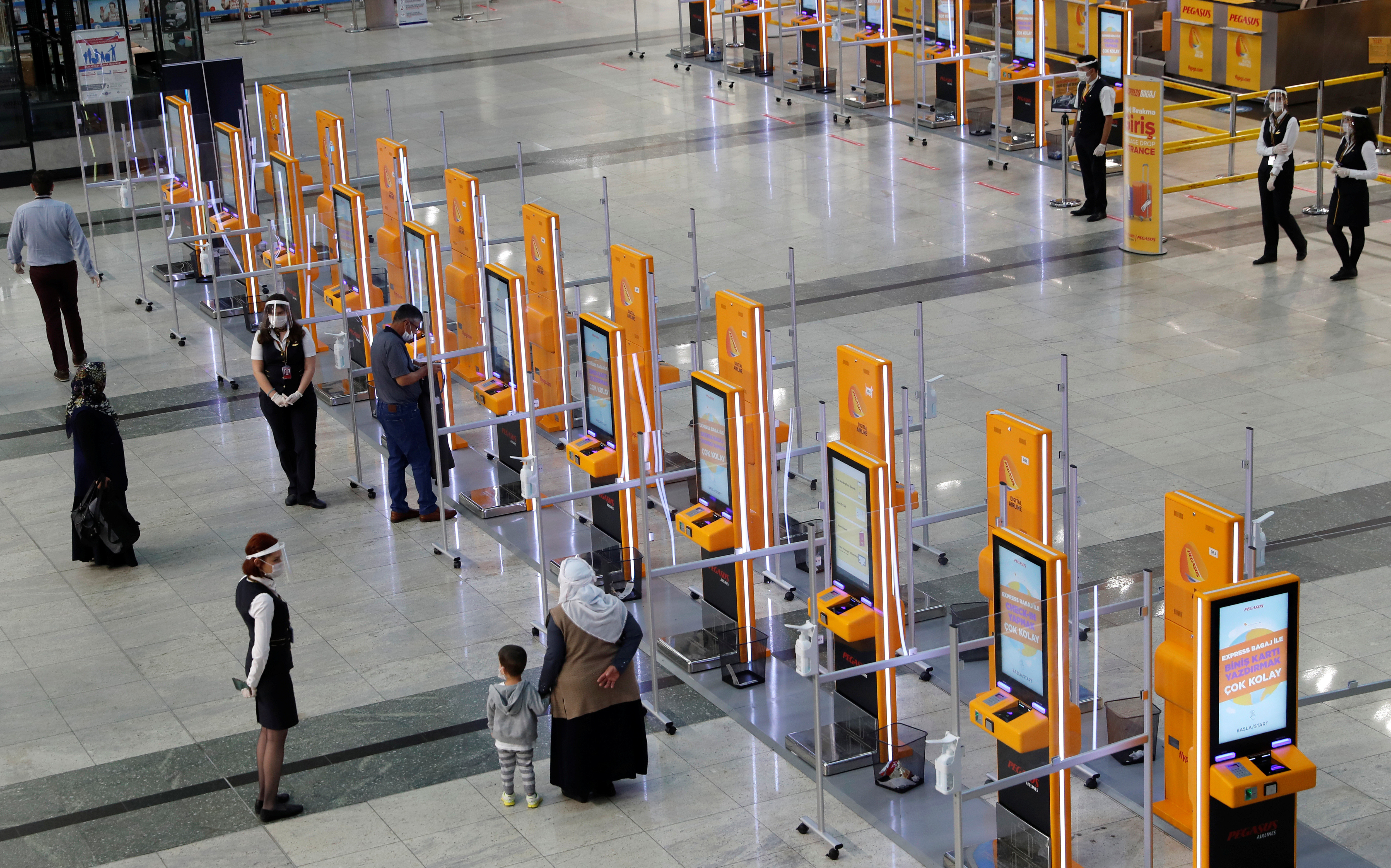 Pegasus Airlines self check-in counters are seen at the nearly empty domestic departure terminal of the Sabiha Gokcen Airport, following the coronavirus disease (COVID-19) outbreak, in Istanbul, Turkey June 11, 2020. REUTERS/Murad Sezer - RC2X6H9AXNI3