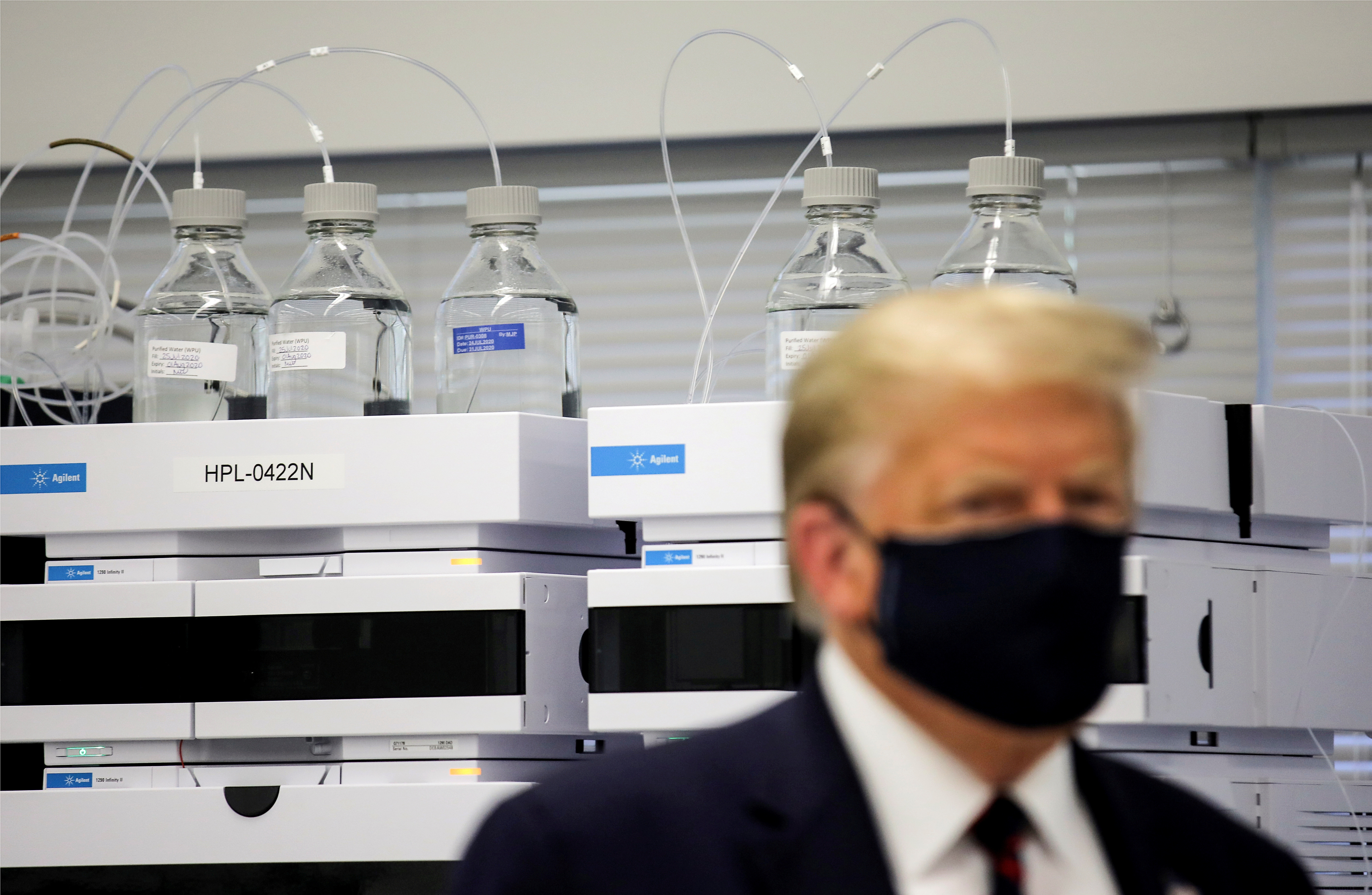 U.S. President Donald Trump wears a protective face mask during a tour of the Fujifilm Diosynth Biotechnologies' Innovation Center, a pharmaceutical manufacturing plant where components for a potential coronavirus disease (COVID-19) vaccine candidate Novavax are being developed, in Morrrisville, North Carolina, U.S., July 27, 2020. REUTERS/Carlos Barria     TPX IMAGES OF THE DAY - RC2W1I9ANJ1H