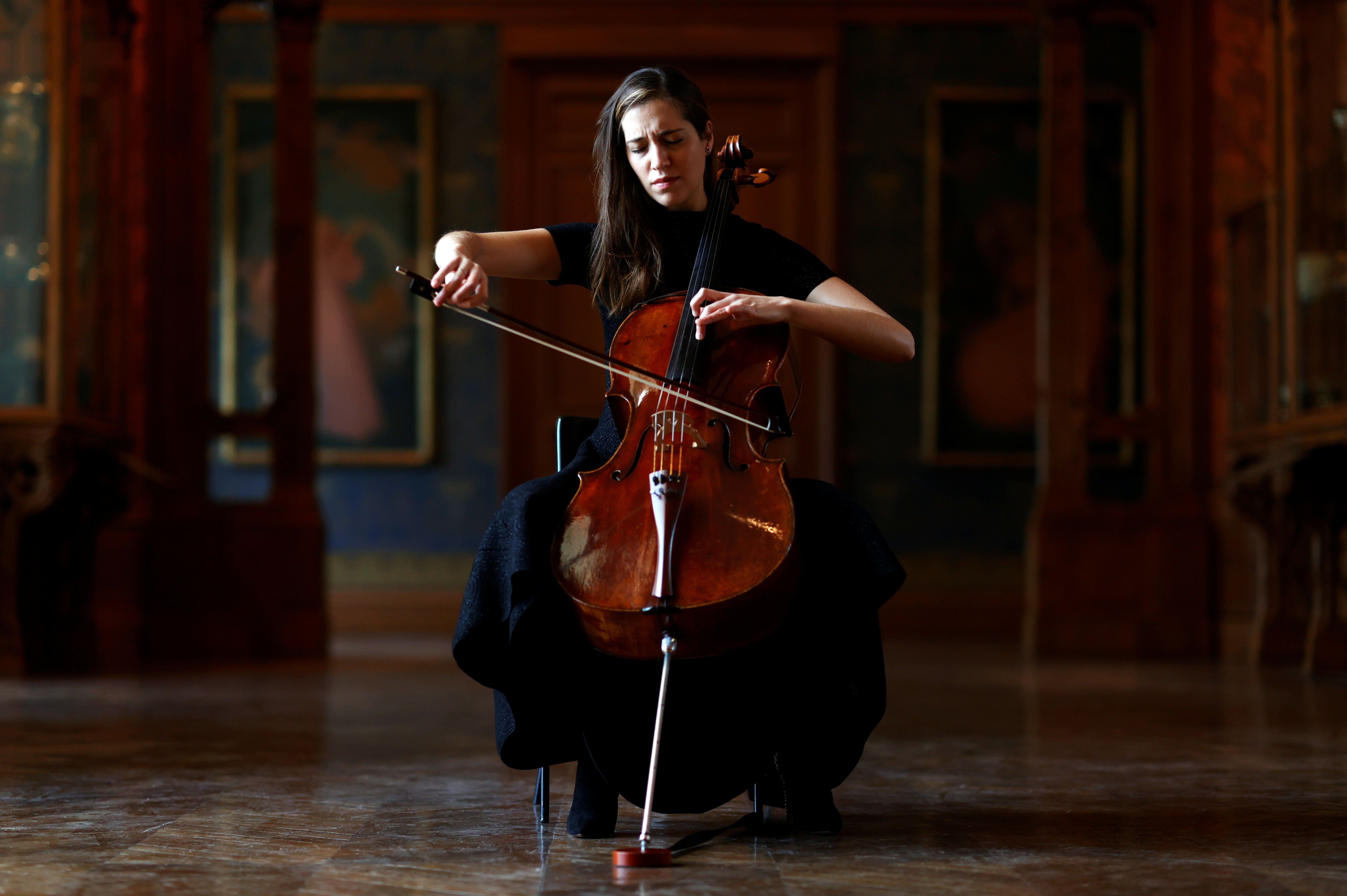 French-Belgian cellist Camille Thomas plays at the Musee des Arts Decoratifs, which is closed to visitors during the lockdown due to the spread of the coronavirus disease (COVID-19), in Paris, France, November 26, 2020. Picture taken November 26, 2020.   REUTERS/Christian Hartmann - RC2NBK9JCXV3