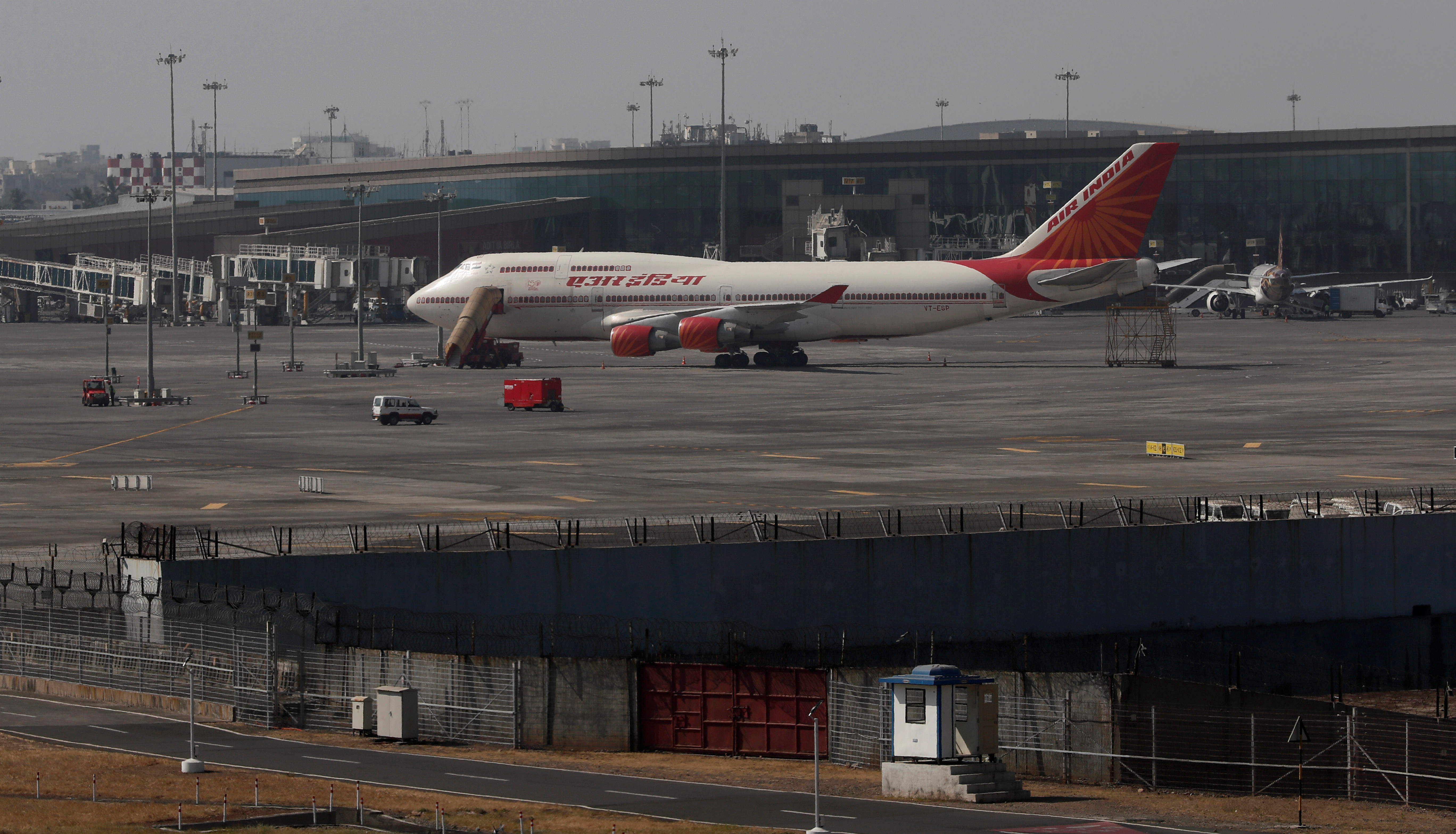An Air India Boeing 747-400 aircraft is seen parked on the tarmac at Chhatrapati Shivaji Maharaj International Airport in Mumbai, India, January 30, 2020. REUTERS/Francis Mascarenhas - RC2BQE94CGUH