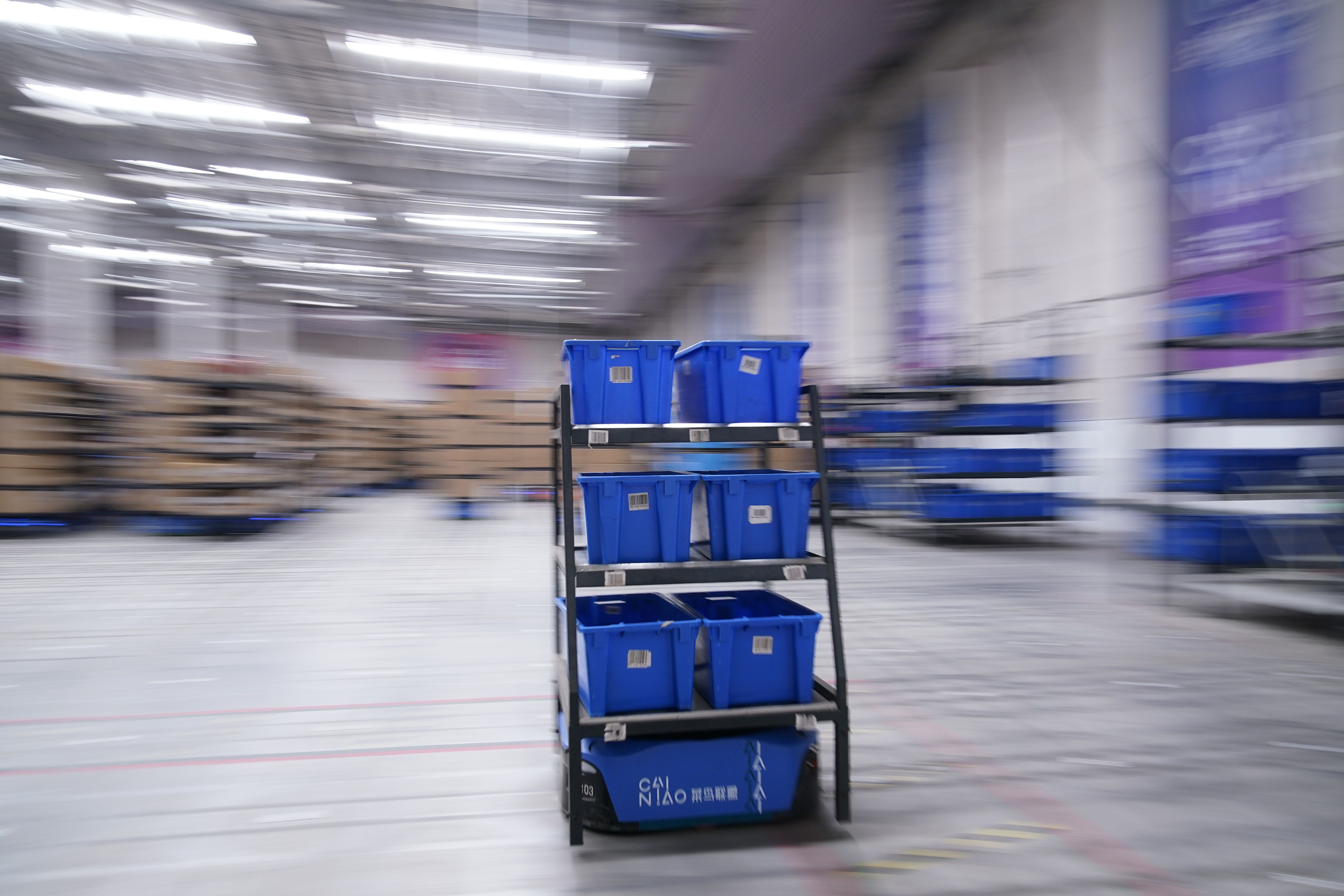 Robot works at a warehouse of Cainiao, Alibaba's logistics unit in Wuxi, Jiangsu province, China October 26, 2020. Picture taken October 26, 2020. REUTERS/Aly Song - RC2VQJ9TTS03