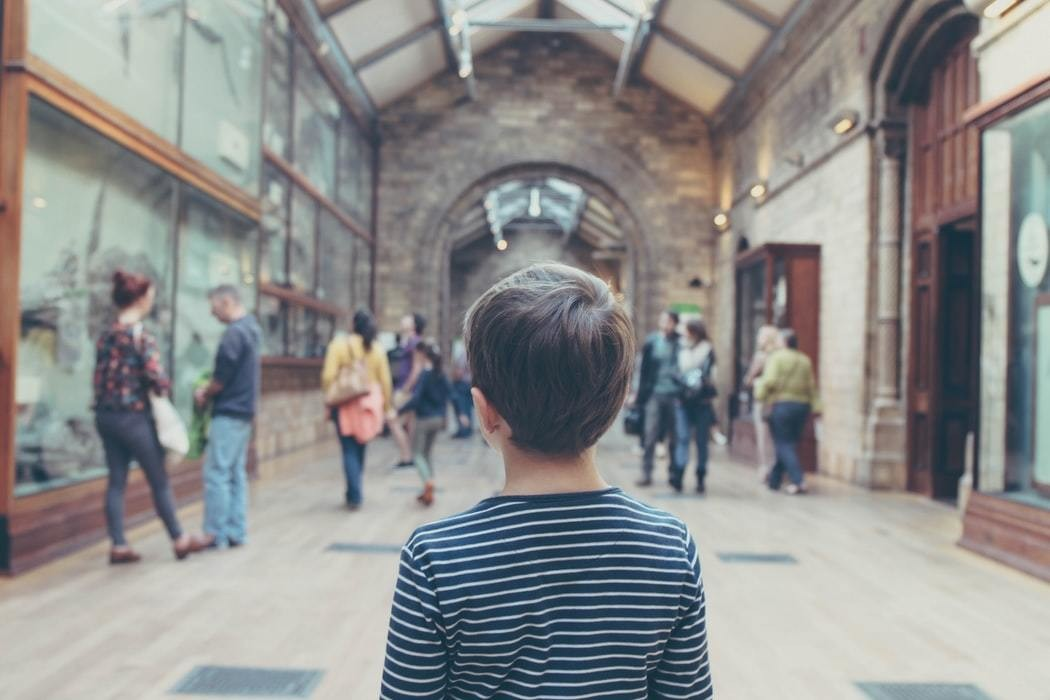 A person looking around a museum.