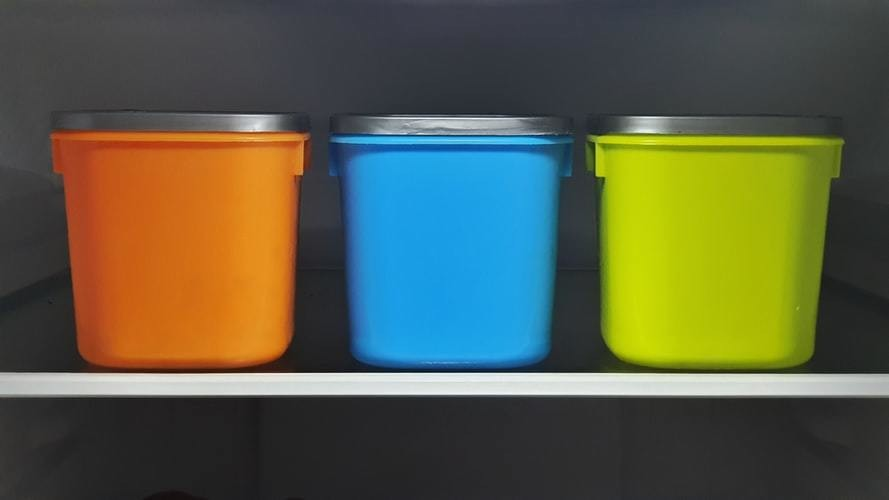 Blue, orange and yellow reusable containers.