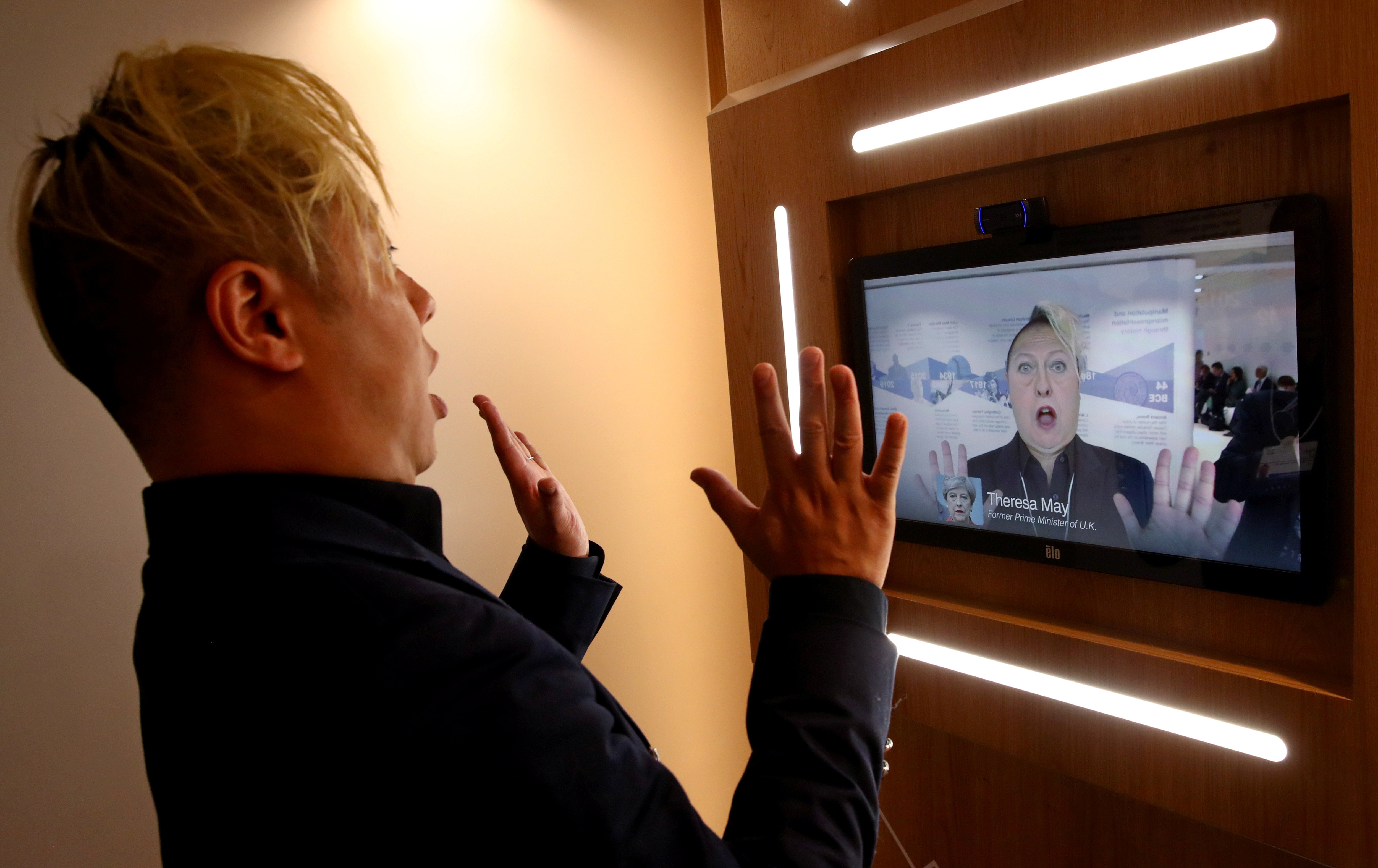Associate professor of computer science at the University of Southern California Hao Li showcases a 'deepfake' video with Britain's former Prime Minister Theresa May during the 50th World Economic Forum (WEF) annual meeting in Davos, Switzerland, January 22, 2020. REUTERS/Denis Balibouse - RC23LE9MMLXY