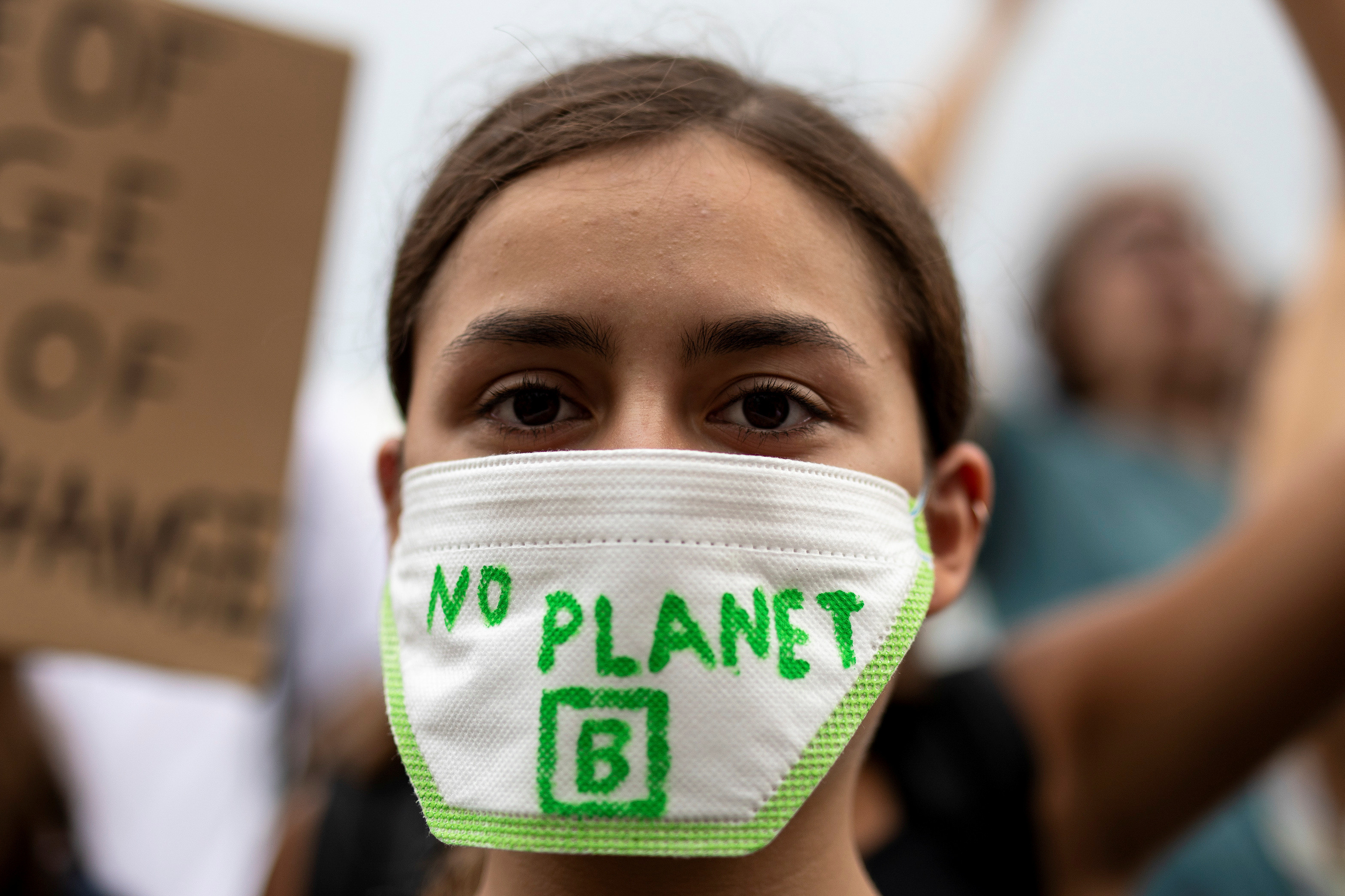 """A Greek student wears a mask reading """"No Planet B"""" during a Global Climate Strike rally of the movement Fridays for Future in Athens, Greece, September 20, 2019. REUTERS/Alkis Konstantinidis - RC1EA6CFACF0"""