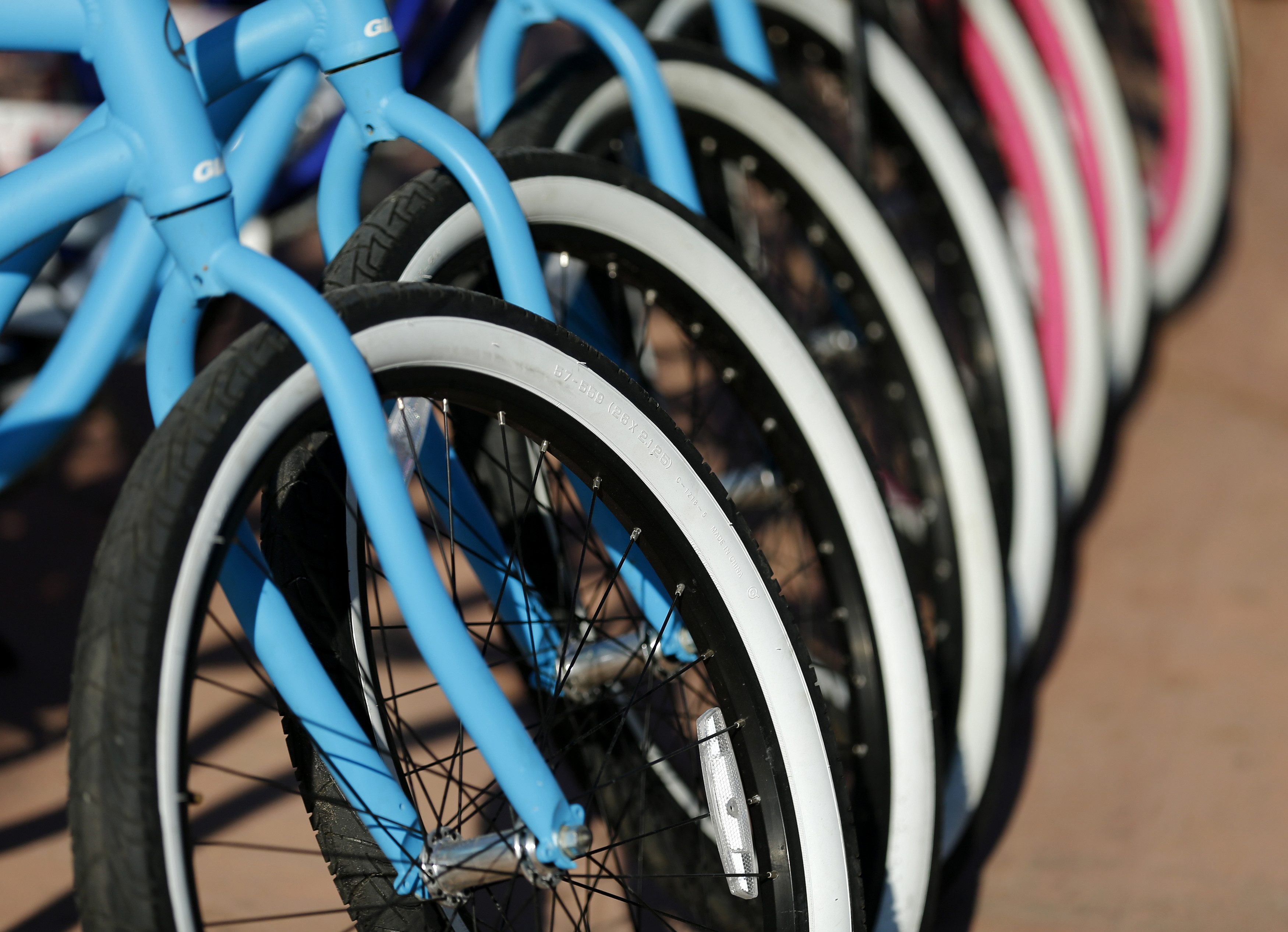 Rental bikes are pictured at a bike rental shop along the beach in Oceanside, California