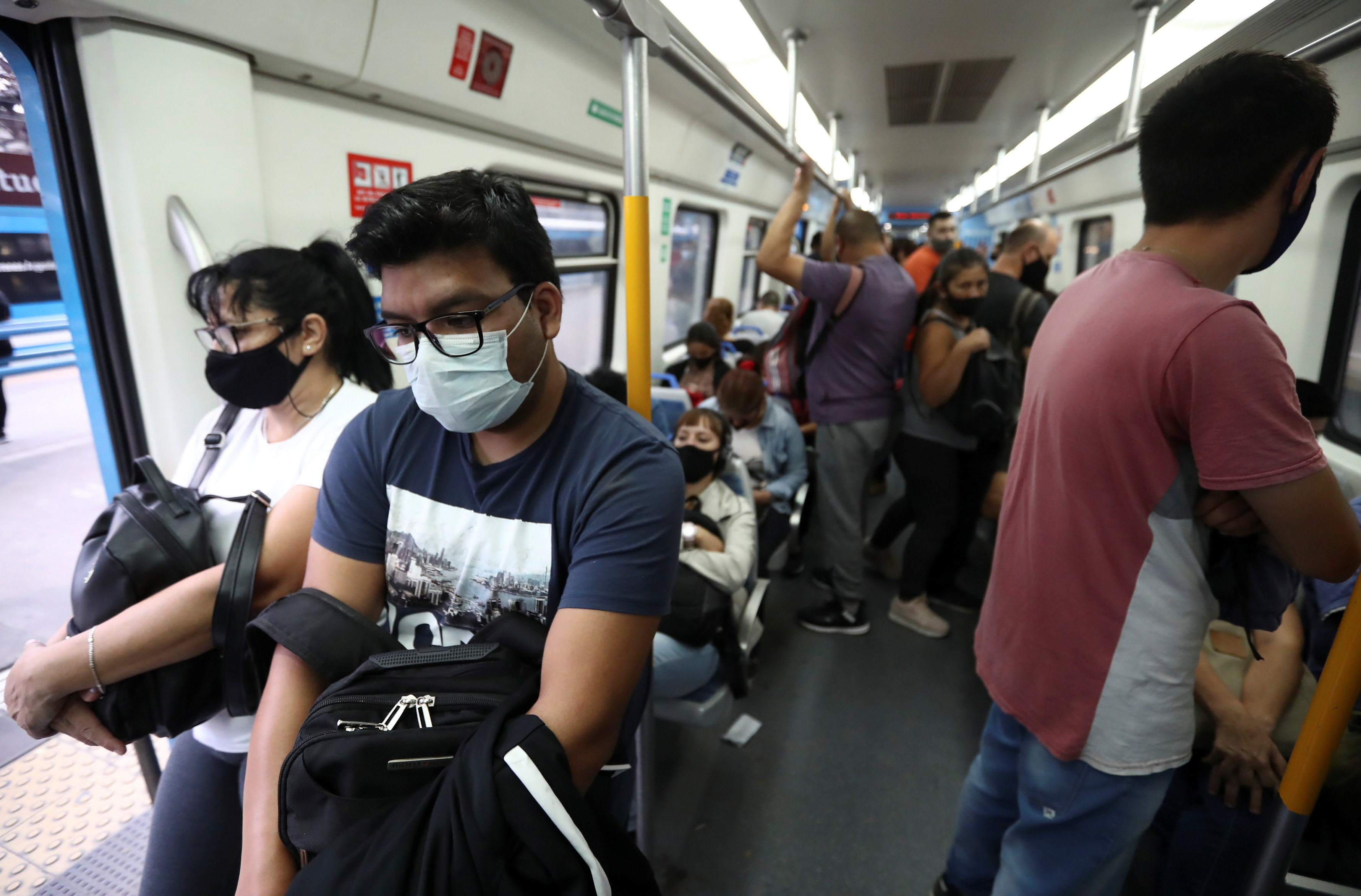 Passengers wearing face masks are seen inside a train at Constitucion train station, amid a rise in cases of the coronavirus disease (COVID-19), in Buenos Aires, Argentina April 8, 2021.