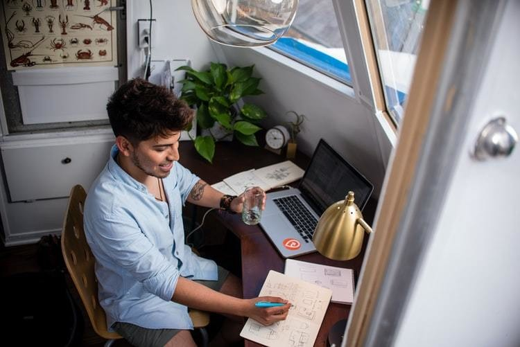 image of a man working from home