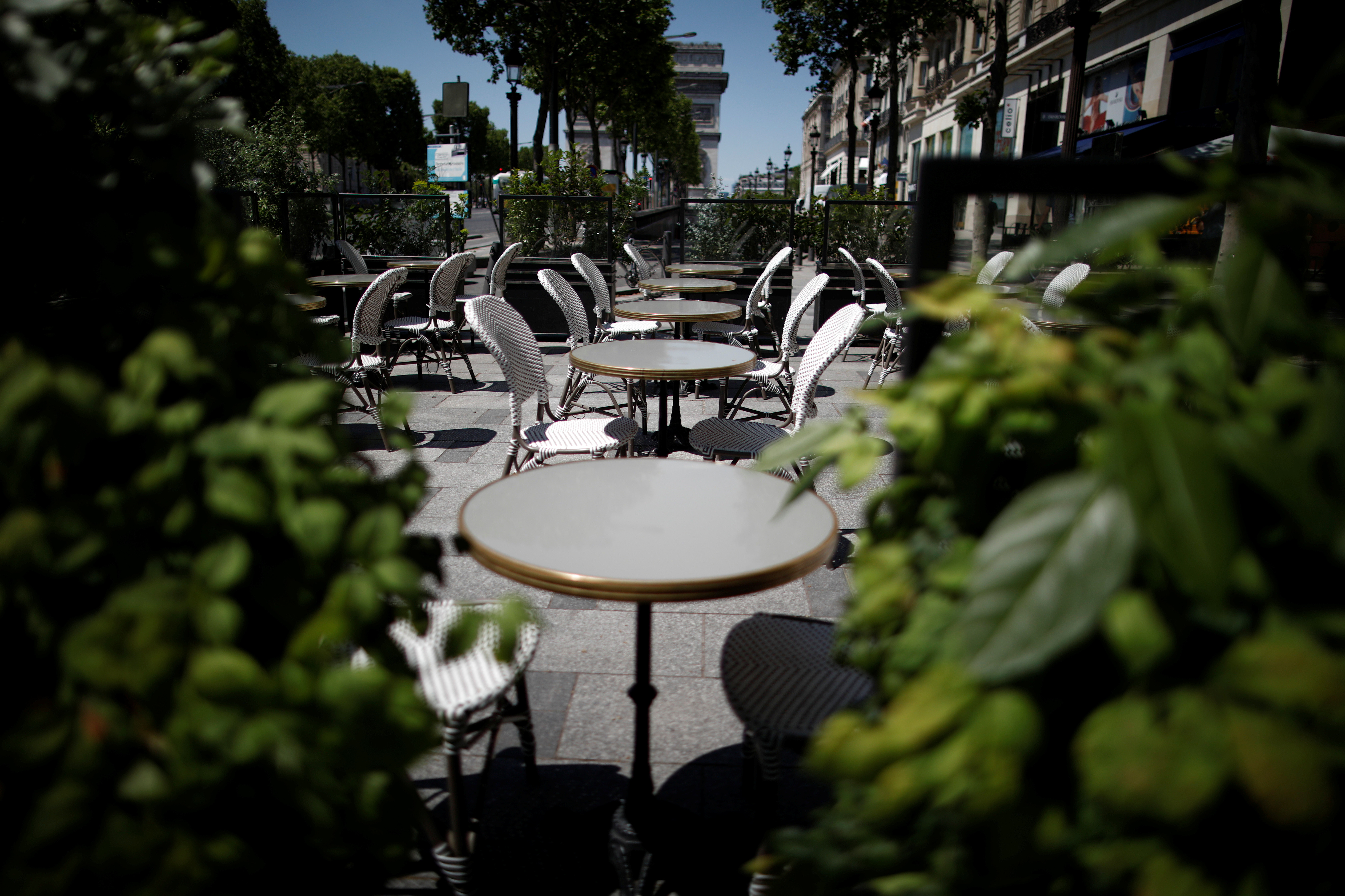 Tables and chairs at a Champs Elysees restaurant