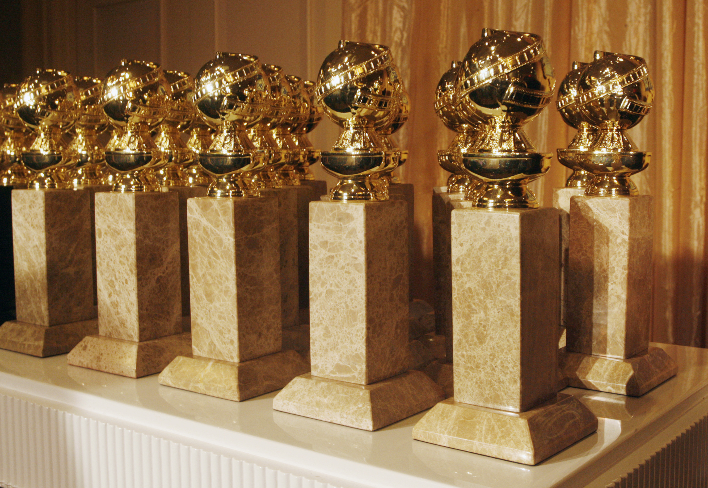 The Hollywood Foreign Press Association's new Golden Globe statuettes are shown during a news conference in Beverly Hills, California January 6, 2009. The new statuette features a facelift to the metal top and a new marble type. The Golden Globe Awards will be held January 11 in Beverly Hills.REUTERS/Fred Prouser (UNITED STATES) - GM1E5170A9601
