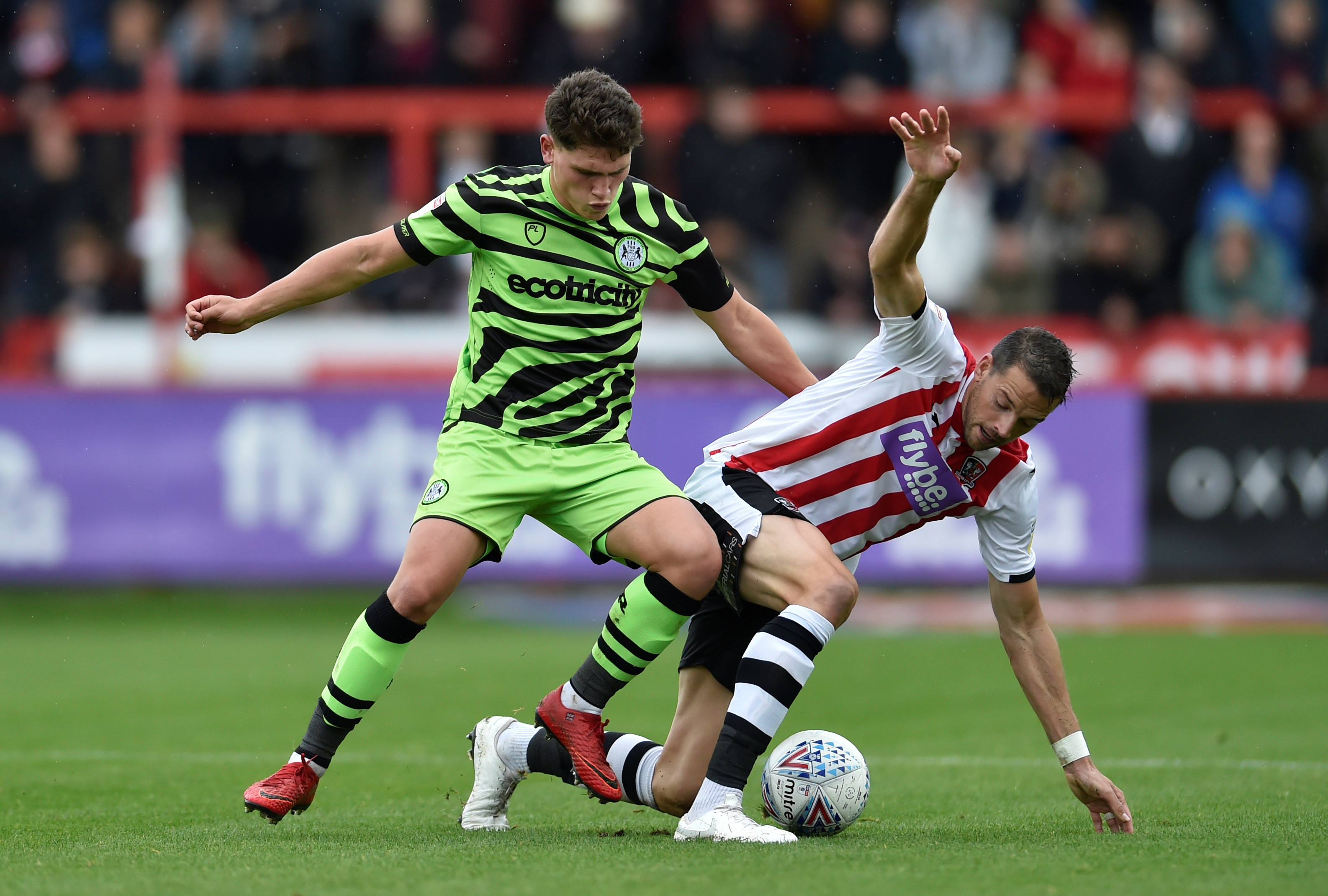 "Soccer Football - League Two - Exeter City v Forest Green Rovers - St James Park, Exeter, Britain - October 12, 2019  Exeter City's Aaron Martin in action with Forest Green Rovers' Matty Stevens  Action Images/Adam Holt  EDITORIAL USE ONLY. No use with unauthorized audio, video, data, fixture lists, club/league logos or ""live"" services. Online in-match use limited to 75 images, no video emulation. No use in betting, games or single club/league/player publications.  Please contact your account representative for further details. - RC16AB92B8A0"