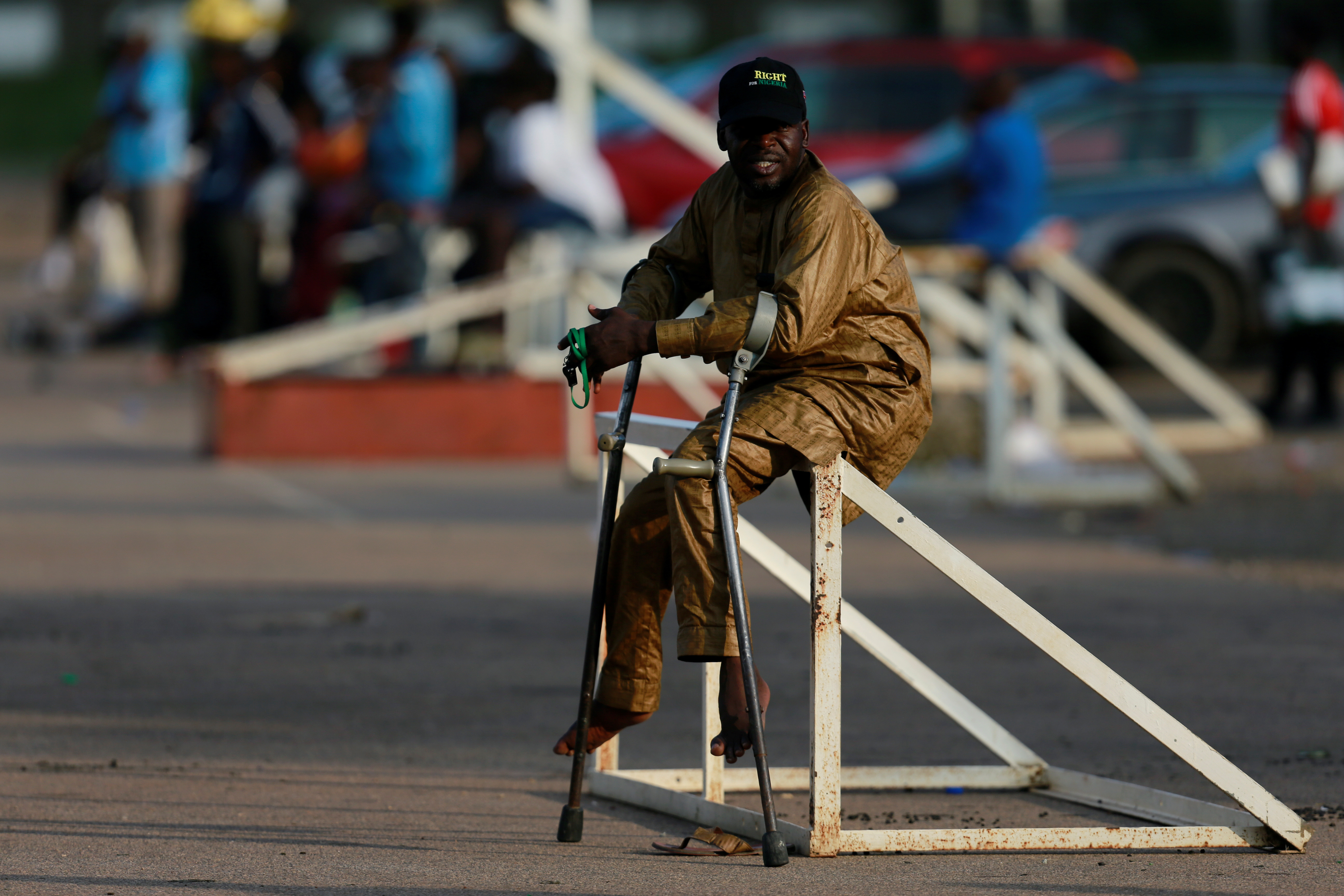 A victim of polio disease sits on a goal pole during a game of para-soccer in Abuja, Nigeria  August 22, 2020. Picture taken August 22, 2020. REUTERS/Afolabi Sotunde - RC2XKI9JC77H