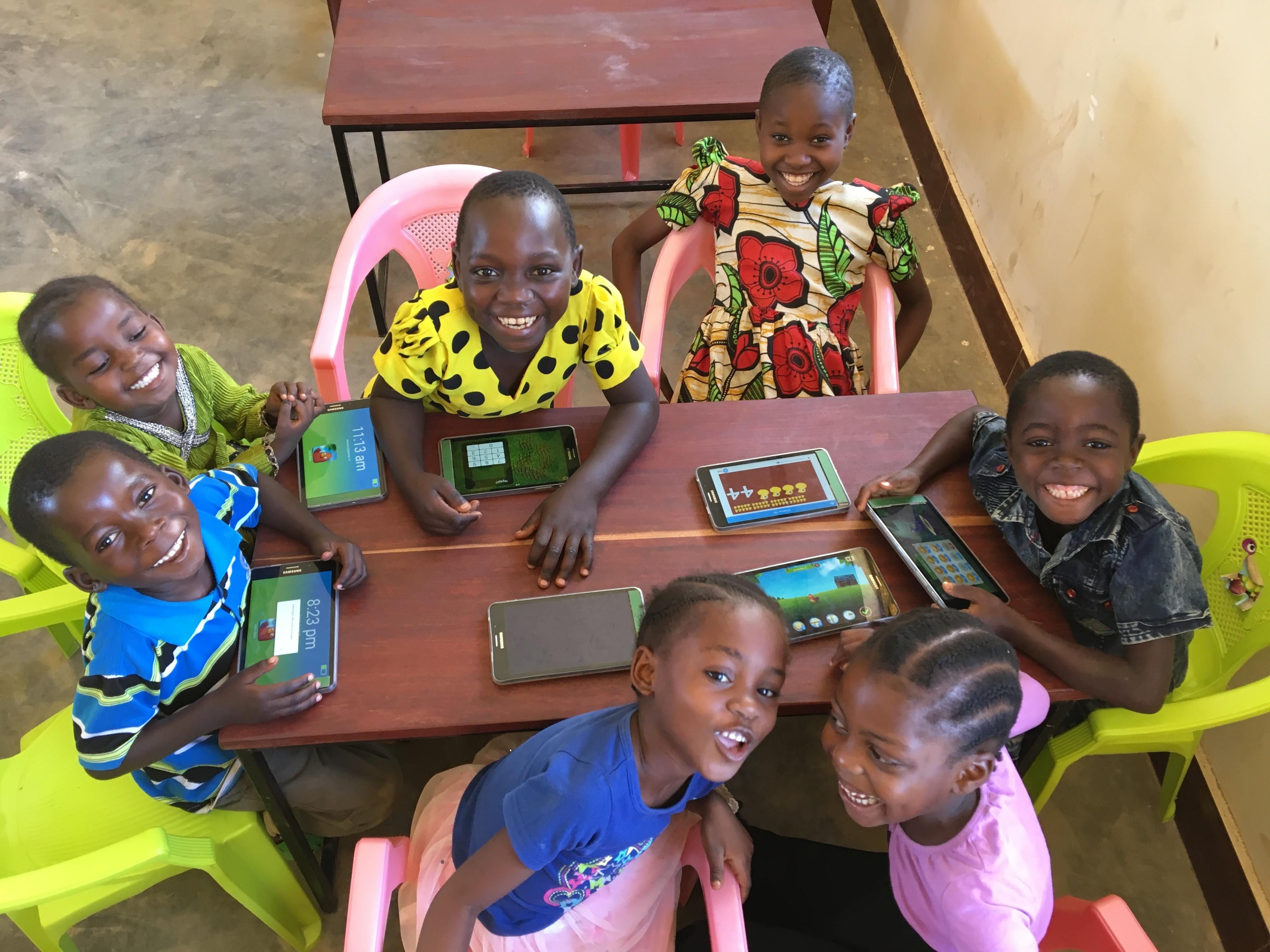 Schwab Foundation social innovators entrepreneurs children with technology tablets smartphones STEM education