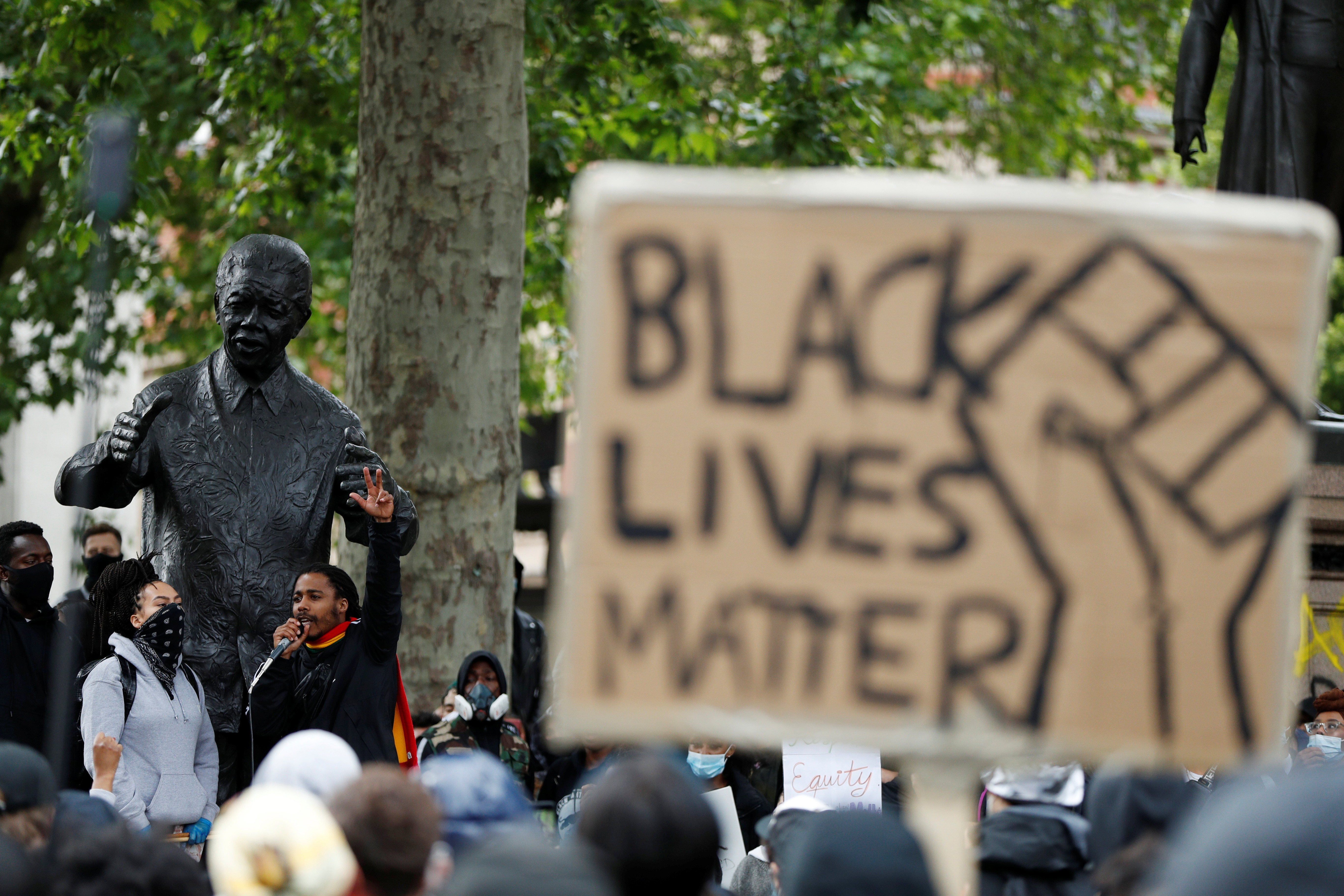Demonstrators are seen infront of the Nelson Mandela statue during a Black Lives Matter protest in Parliament Square, following the death of George Floyd who died in police custody in Minneapolis, London, Britain, June 6, 2020. REUTERS/John Sibley - RC2S3H9AV1A4