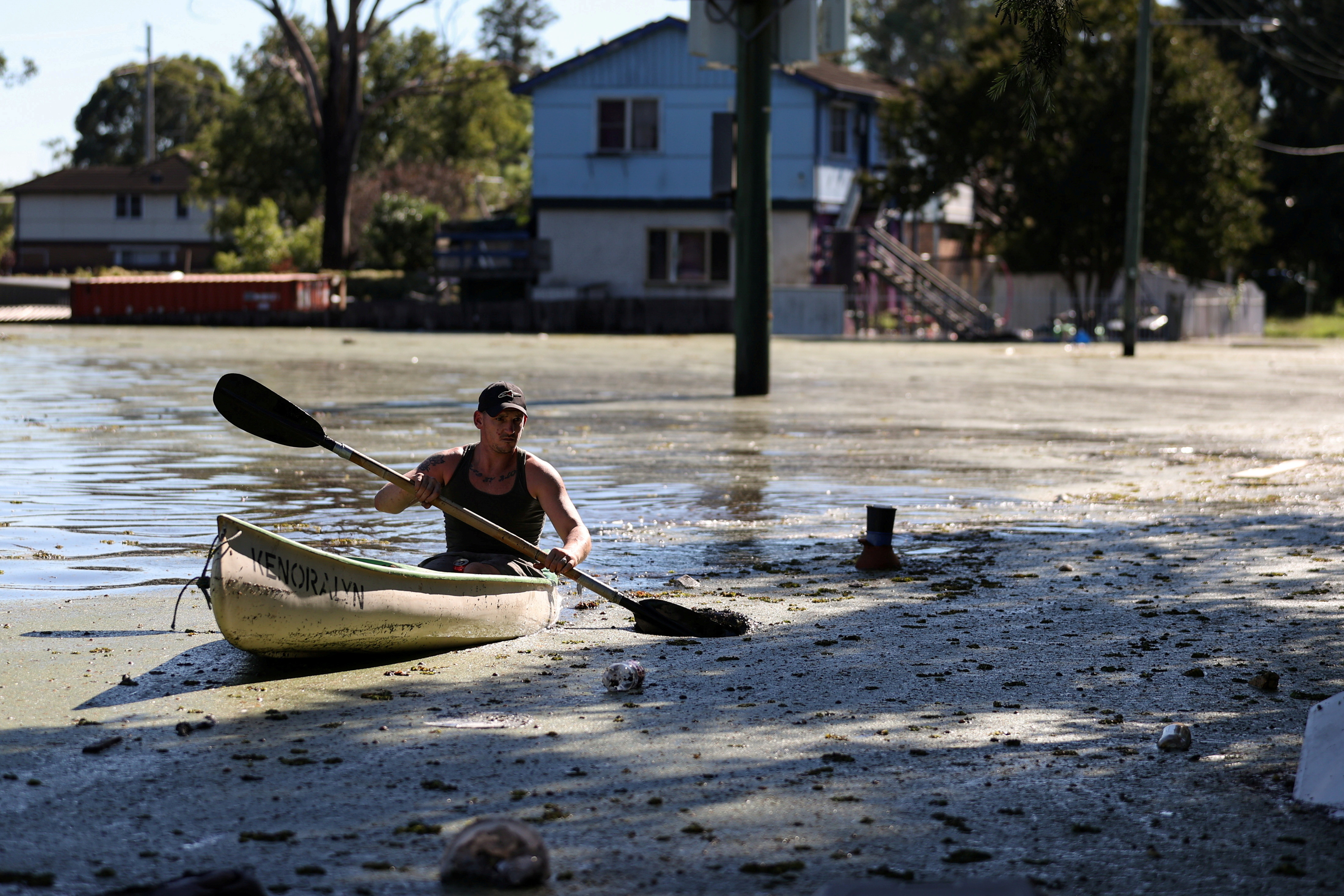 a local resident paddles a kayak over a flooded street as severe flooding affects the suburb of Windsor after days of heavy rain in the state of New South Wales, in Sydney, Australia, March 24, 2021