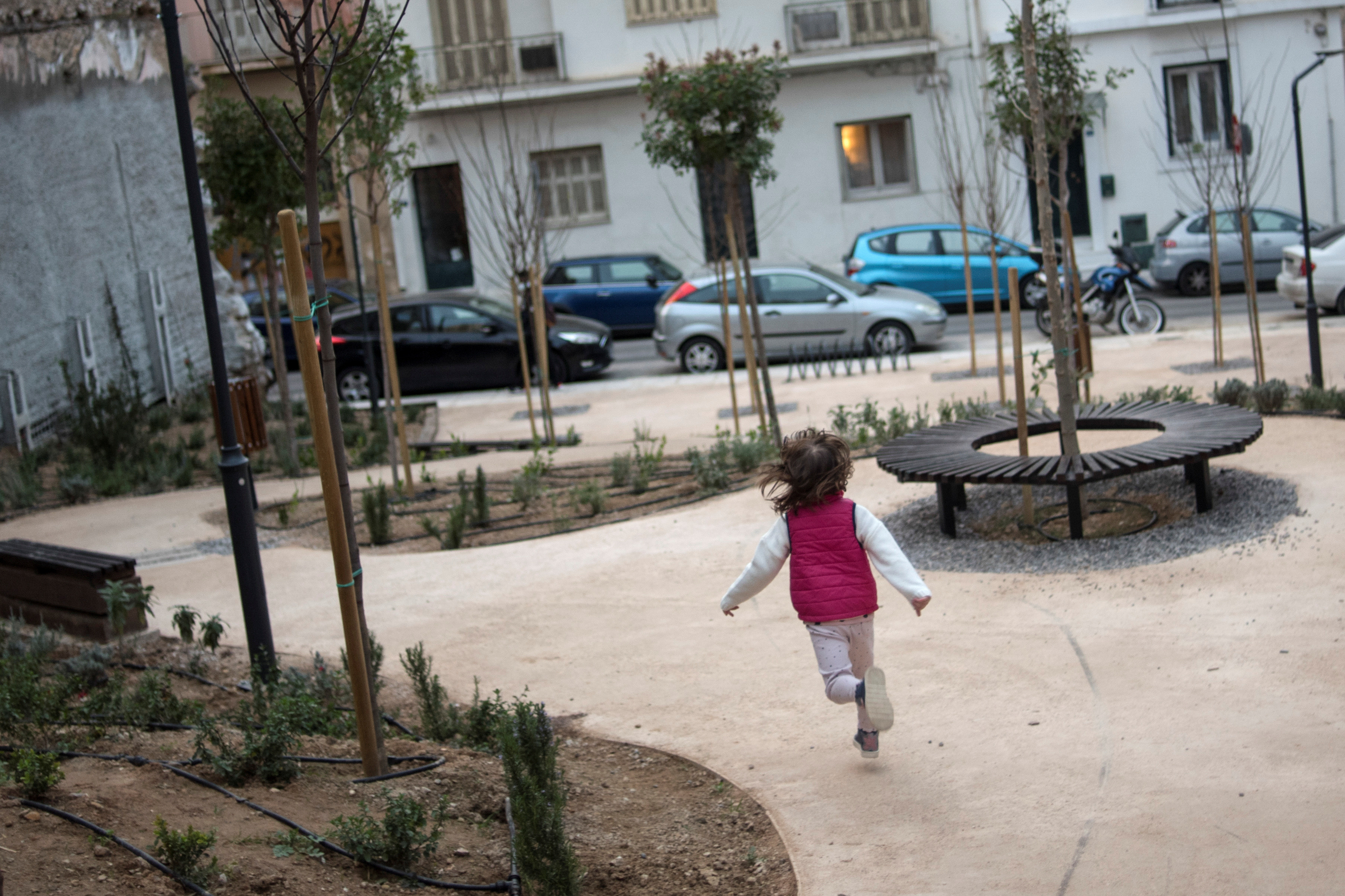 A child runs in a pocket park, in Athens, Greece, March 5, 2021. Picture taken March 5, 2021. REUTERS/Louiza Vradi - RC219M9QXMUV
