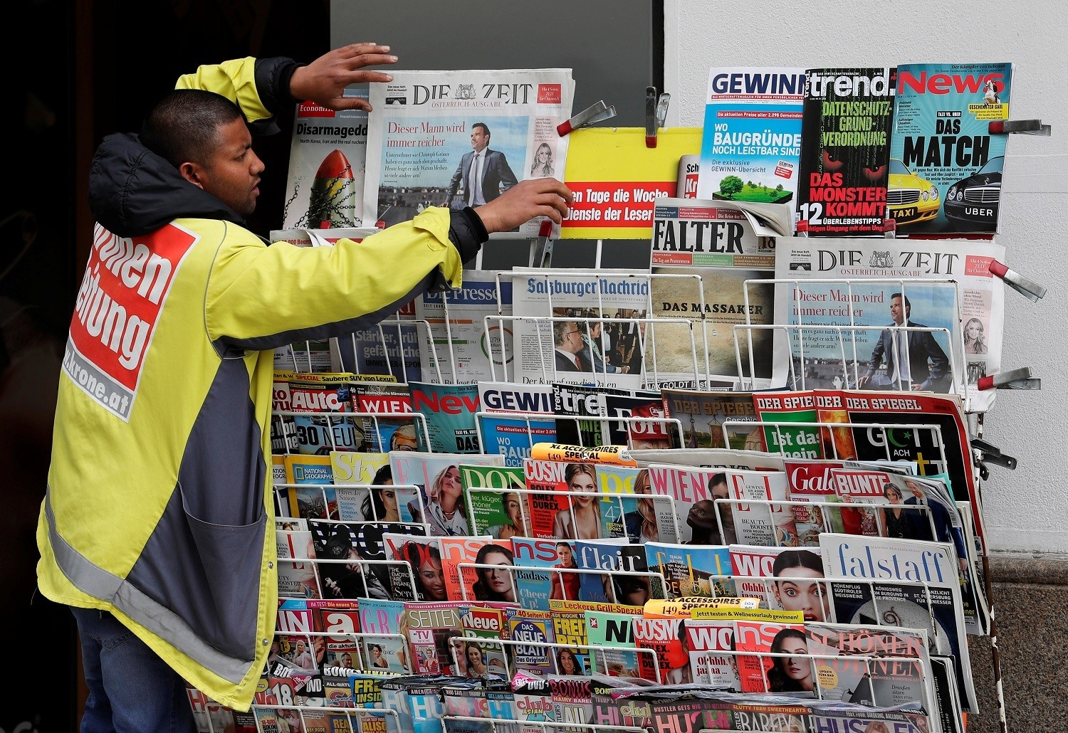 A newspaper seller adjusts papers at his stand in the centre of Vienna, Austria, May 4, 2018. REUTERS/Heinz-Peter Bader - RC1CED3D9560