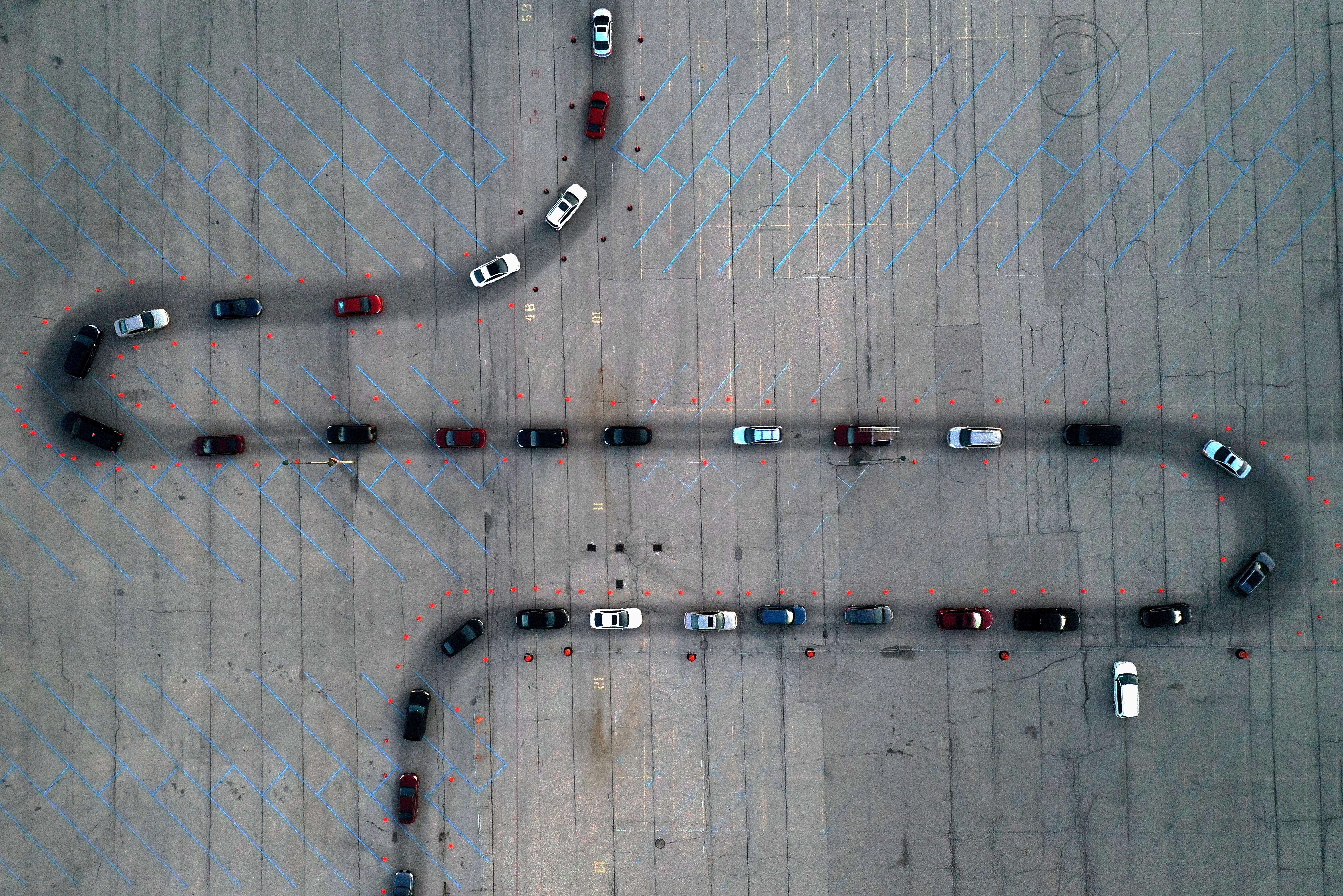 An aerial view of vehicles waiting at a drive-thru COVID-19 testing site in the parking lot of Miller Park, as the coronavirus (COVID-19) disease outbreak continues in Milwaukee, Wisconsin, U.S., November 5, 2020. Picture taken with a drone. REUTERS/Bing Guan     TPX IMAGES OF THE DAY - RC2CXJ93Y99M