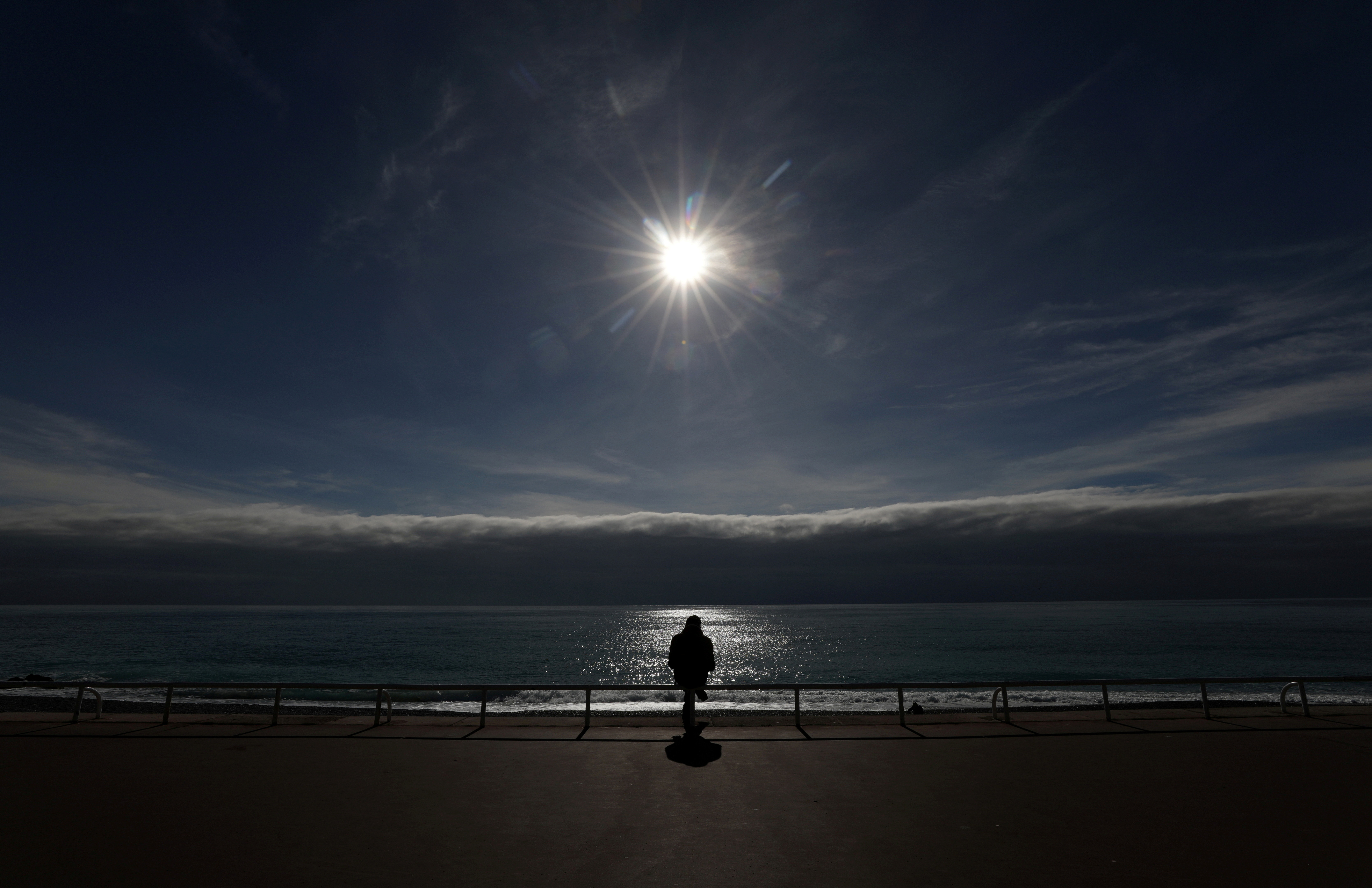 A man sits on the Promenade des Anglais in Nice amid the coronavirus disease (COVID-19) outbreak in France, February 16, 2021.   REUTERS/Eric Gaillard     TPX IMAGES OF THE DAY - RC2QTL90HGS4