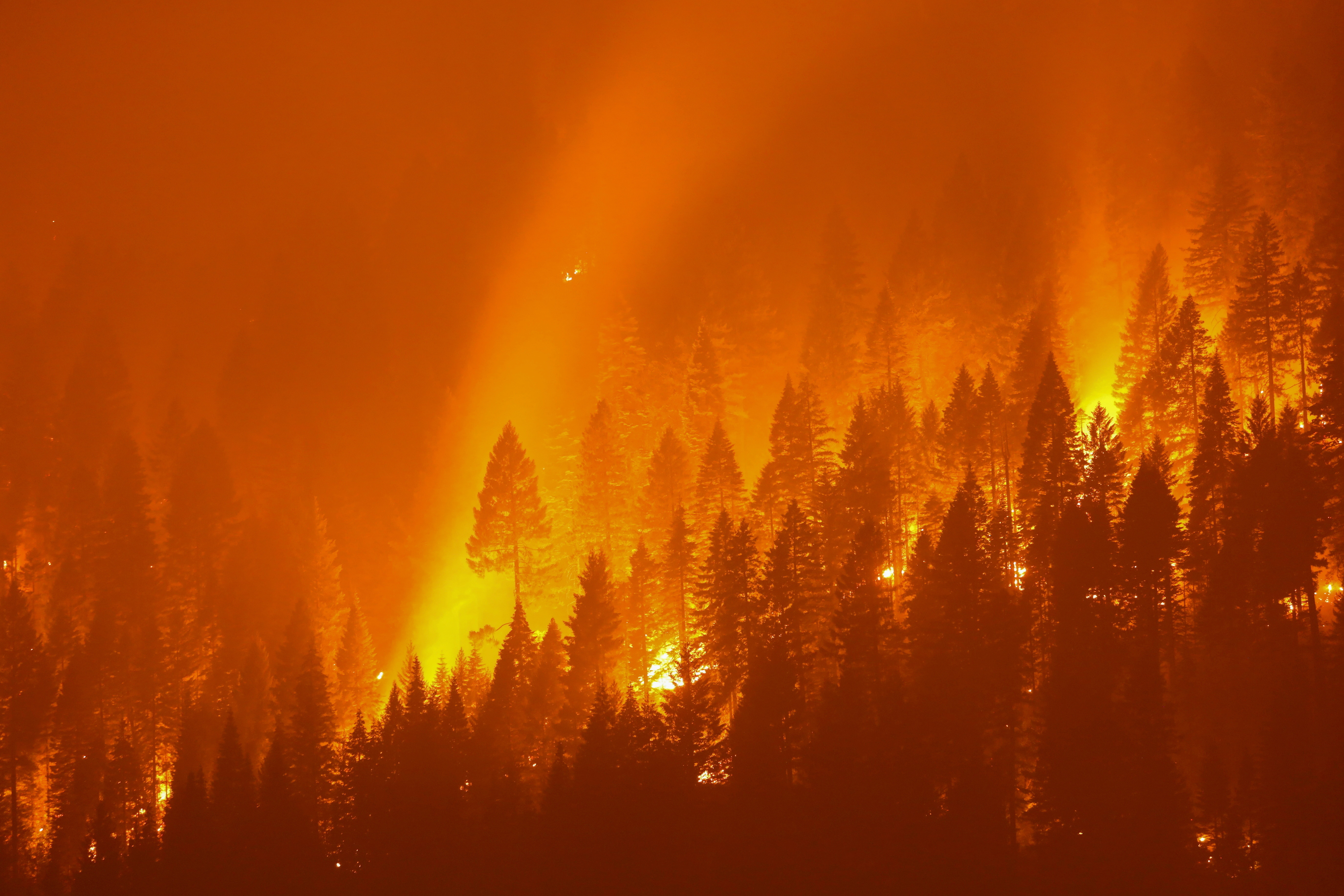 the Dixie Fire, covering over 200,000 acres, burns at night in Taylorsville, California, U.S., July 27, 2021