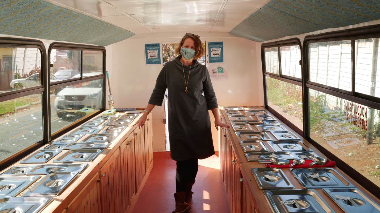 Ilka Stein, a consultant and facilitator, poses for a photo inside the Skhaftin food bus in Johannesburg, South Africa. May 18, 2021.
