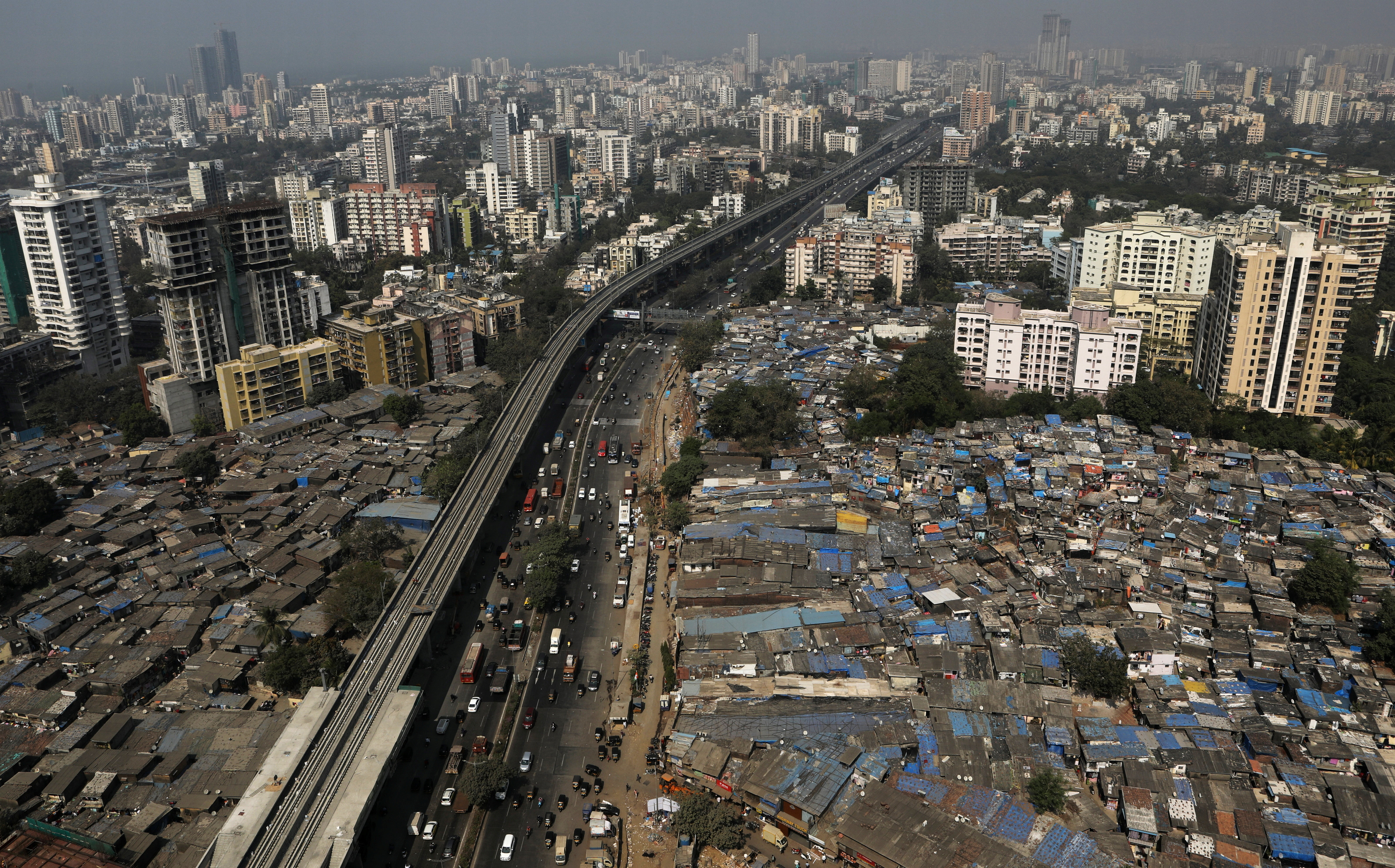Slums and high-rise buildings in close proximity in Mumbai, India.