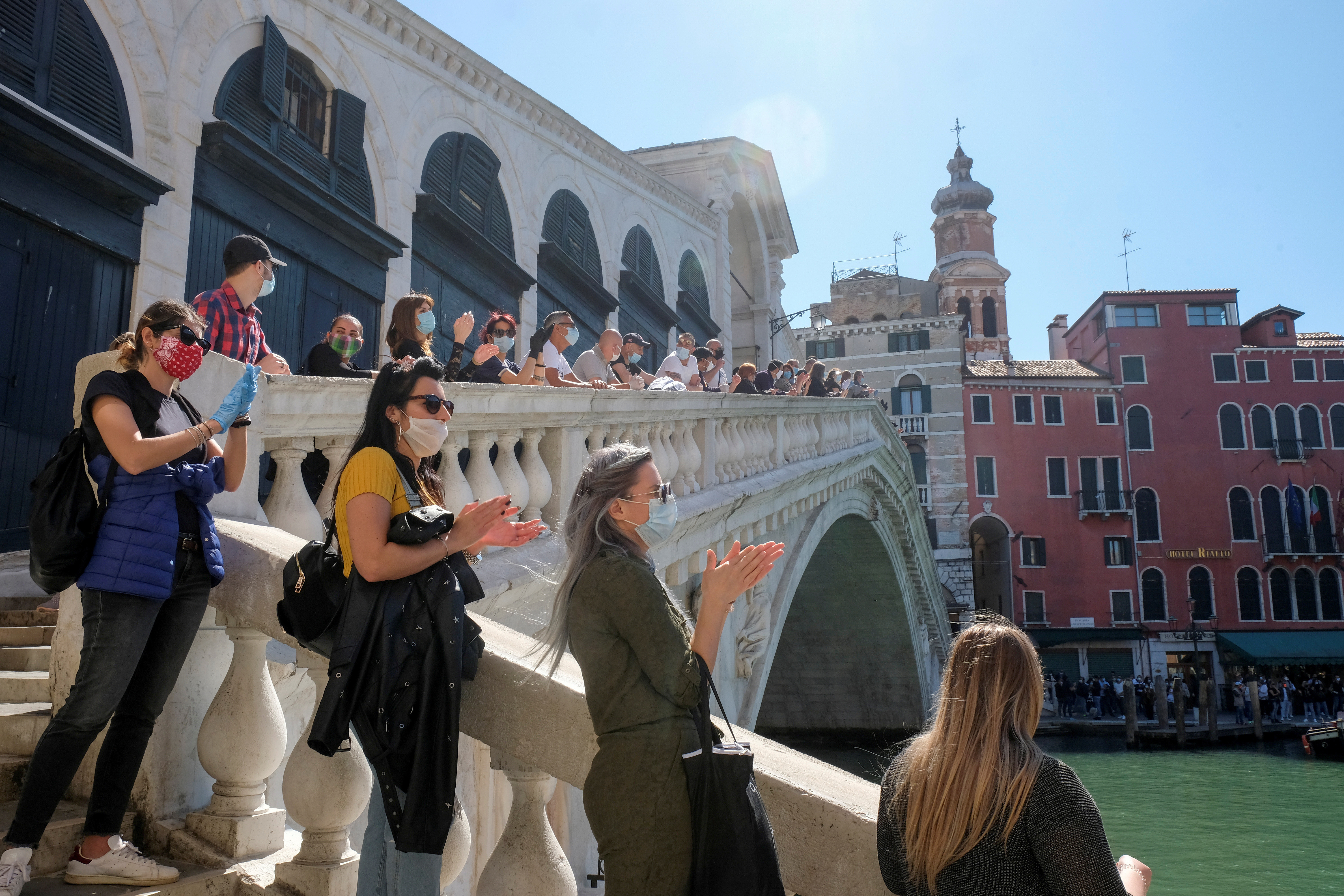 A rally organised by small business owners stops by the Rialto bridge to commemorate the health care workers who died amid the outbreak, as Italy begins a staged end to a nationwide lockdown due to a spread of the coronavirus disease (COVID-19), in Venice, Italy, May 4, 2020. REUTERS/Manuel Silvestri     TPX IMAGES OF THE DAY - RC2MHG9PDEU5