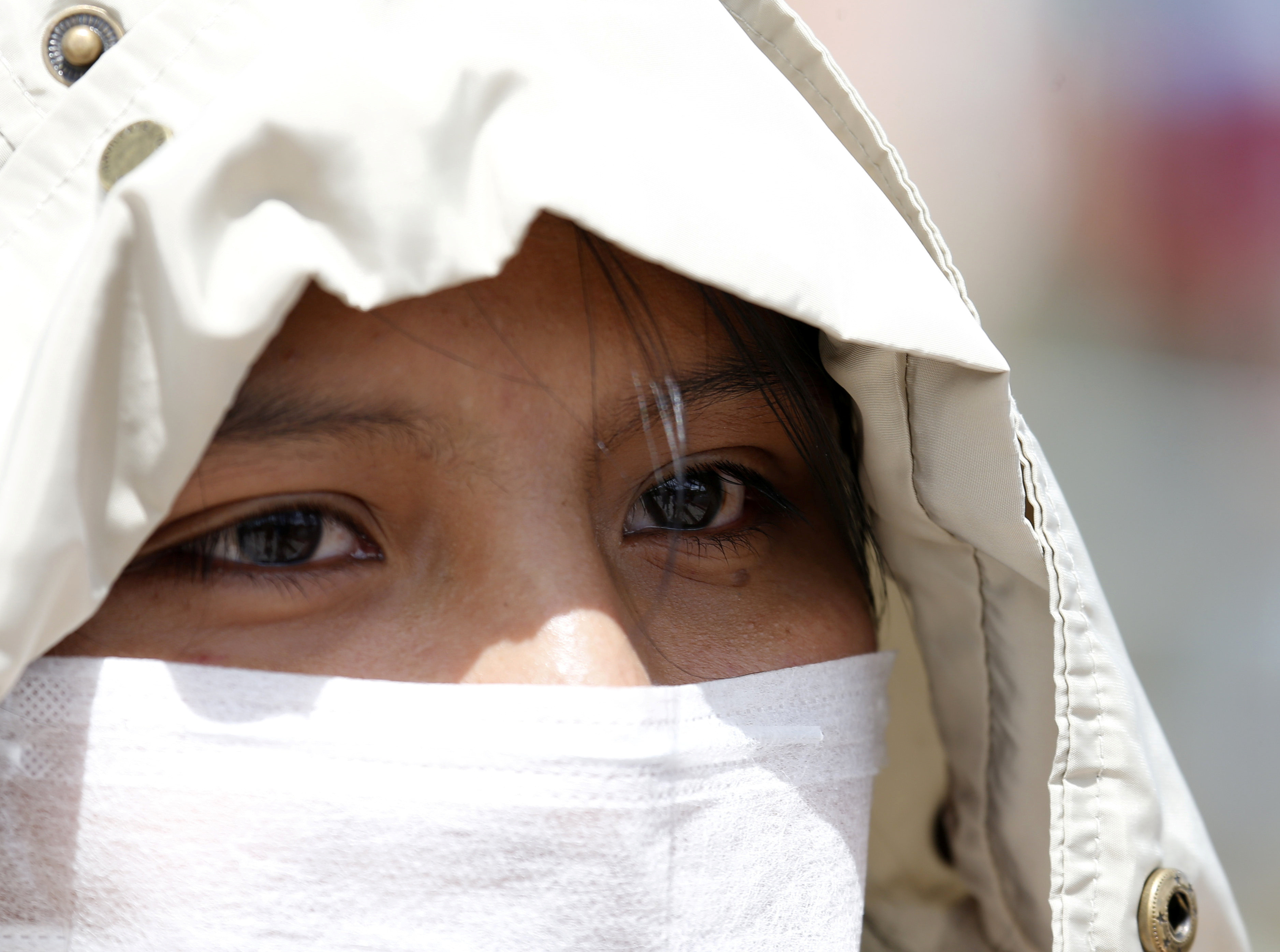 Mariluna Apaza, a stranded Peruvian passenger, talks with Reuters at the border line between Peru and Bolivia after Peru's government's announcement of border closure in a bid to slow the spread of the new coronavirus (COVID-19), in Desaguadero, Bolivia, March 17, 2020. REUTERS/David Mercado - RC2YLF9Z12TR