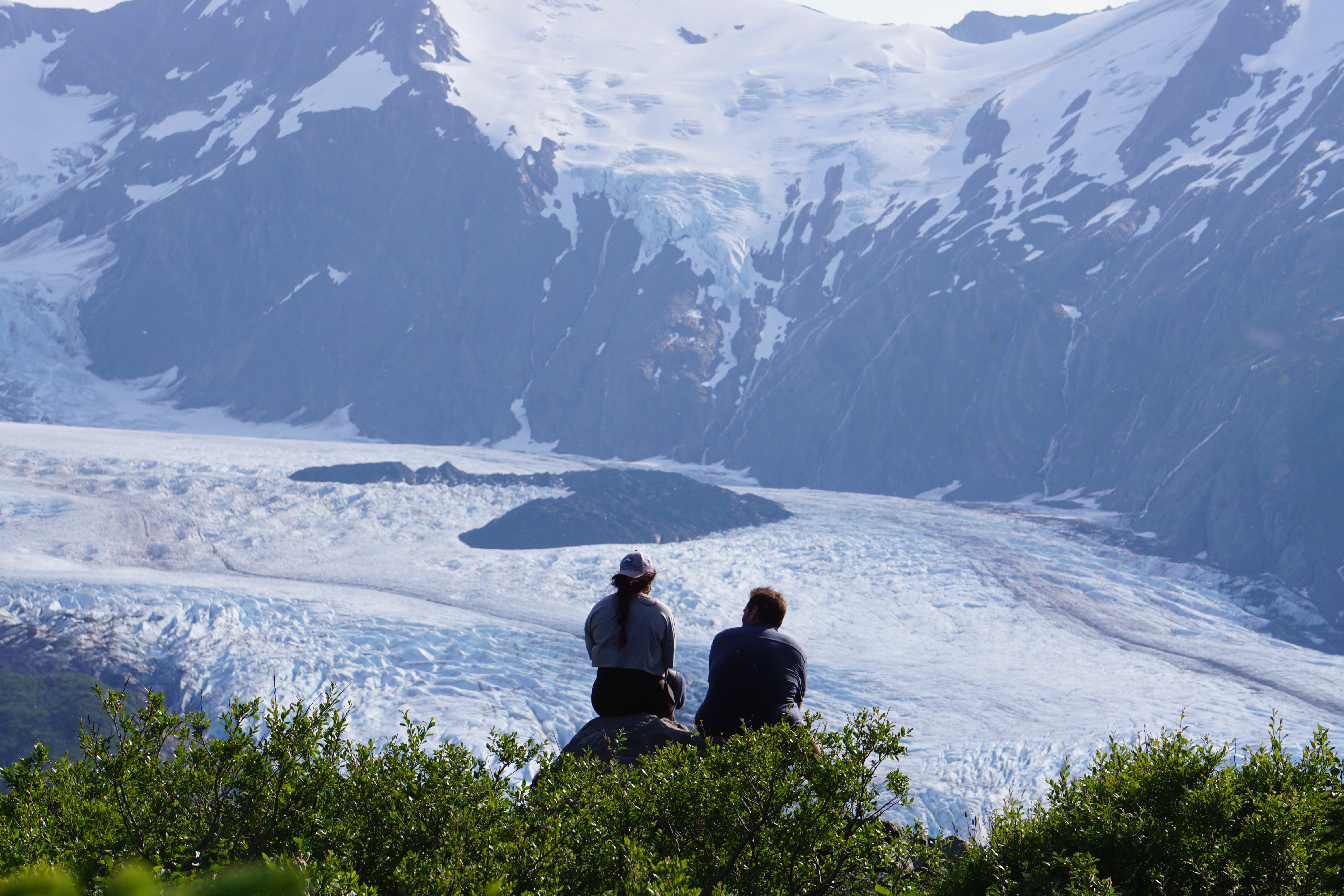 Portage Glacier as seen from Portage Pass, as hikers look on, in Chugach National Forest in Alaska, U.S. July 7, 2020. Picture taken July 7, 2020. REUTERS/Yereth Rosen - RC2XEL97K9LM